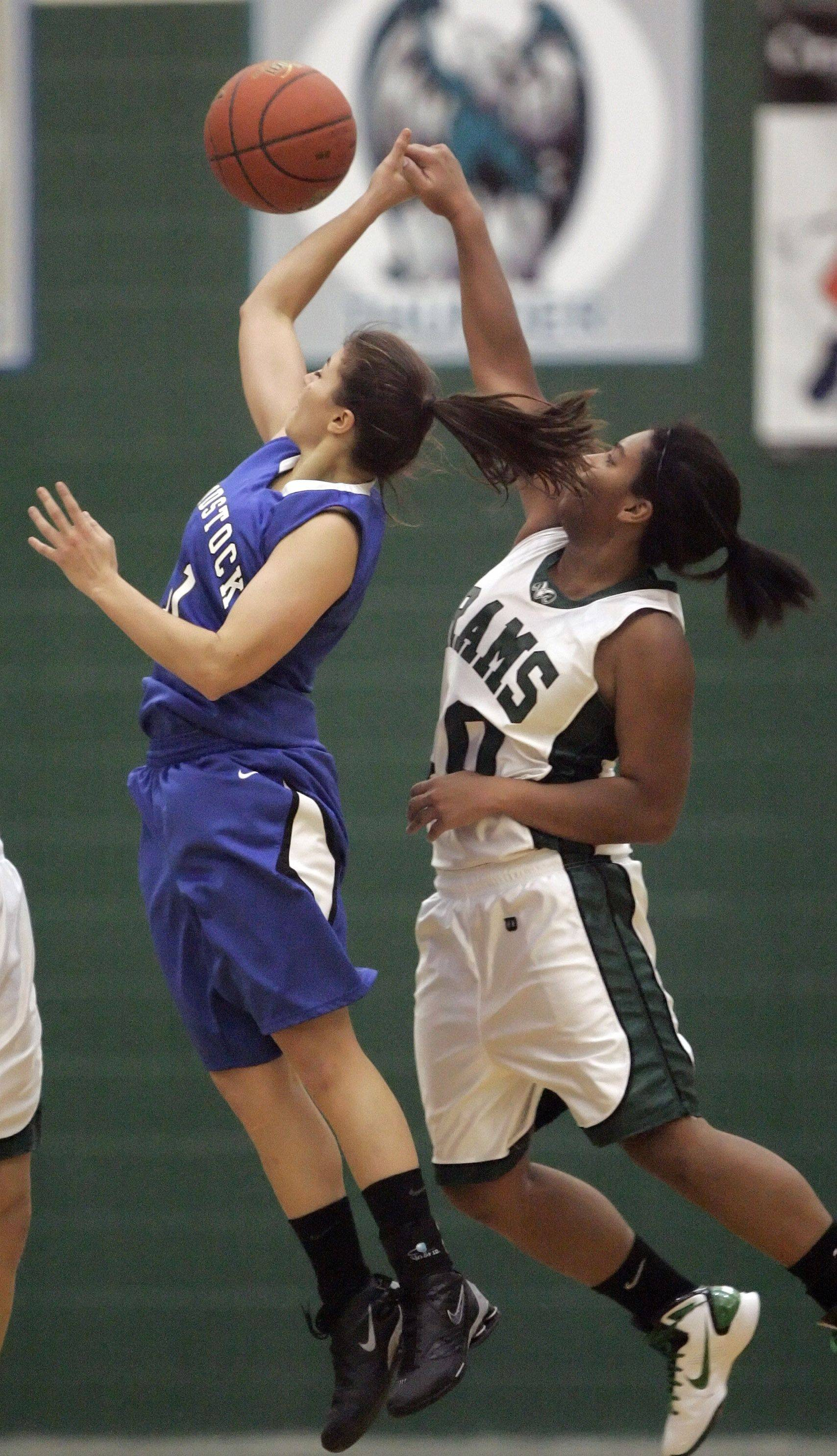 Grayslake Central's Alex Scarbro blocks the shoot of Woodstock's Odessa Peters .