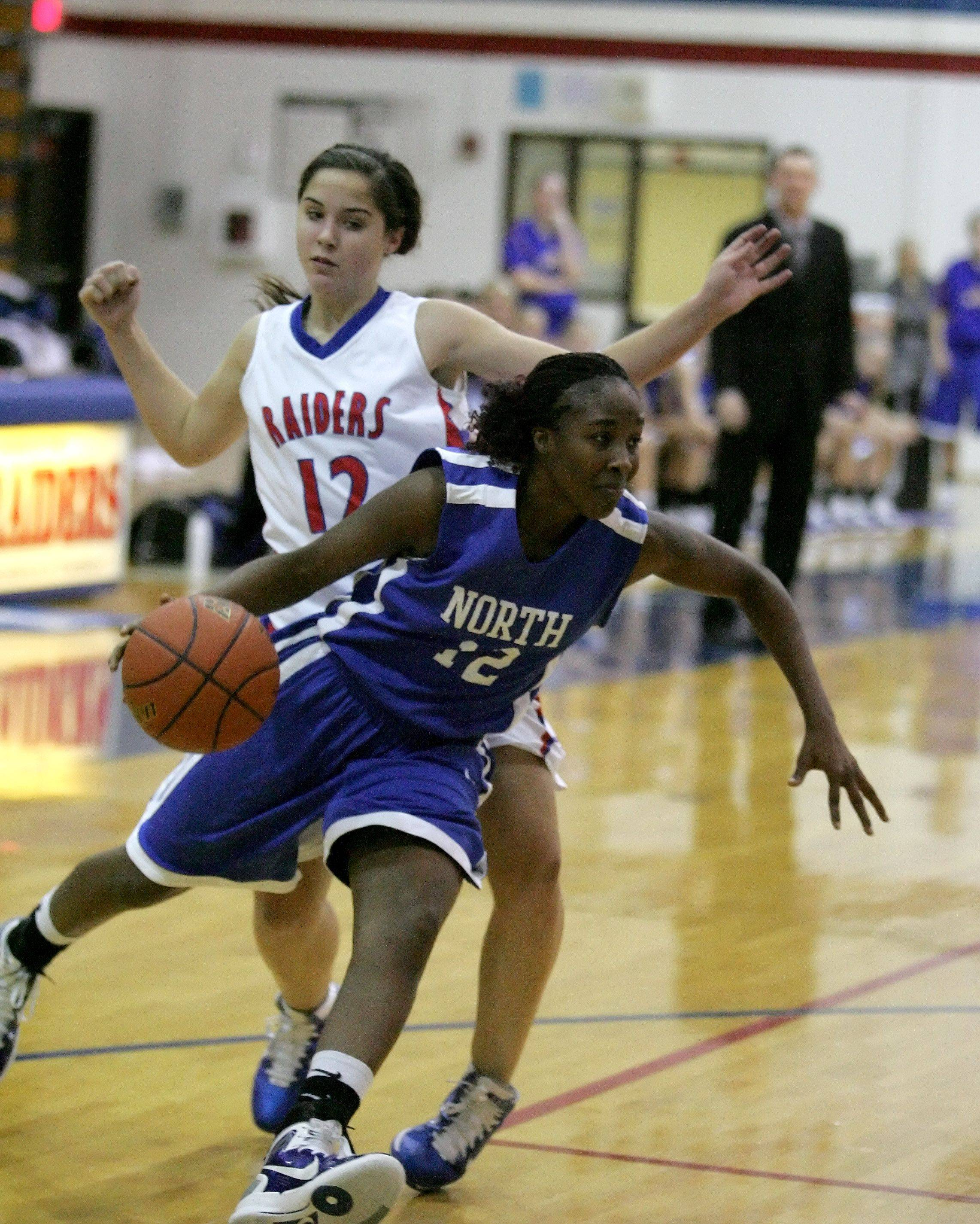 Fantasia Vine of Wheaton North drives around Alyse Cates of Glenbard South.