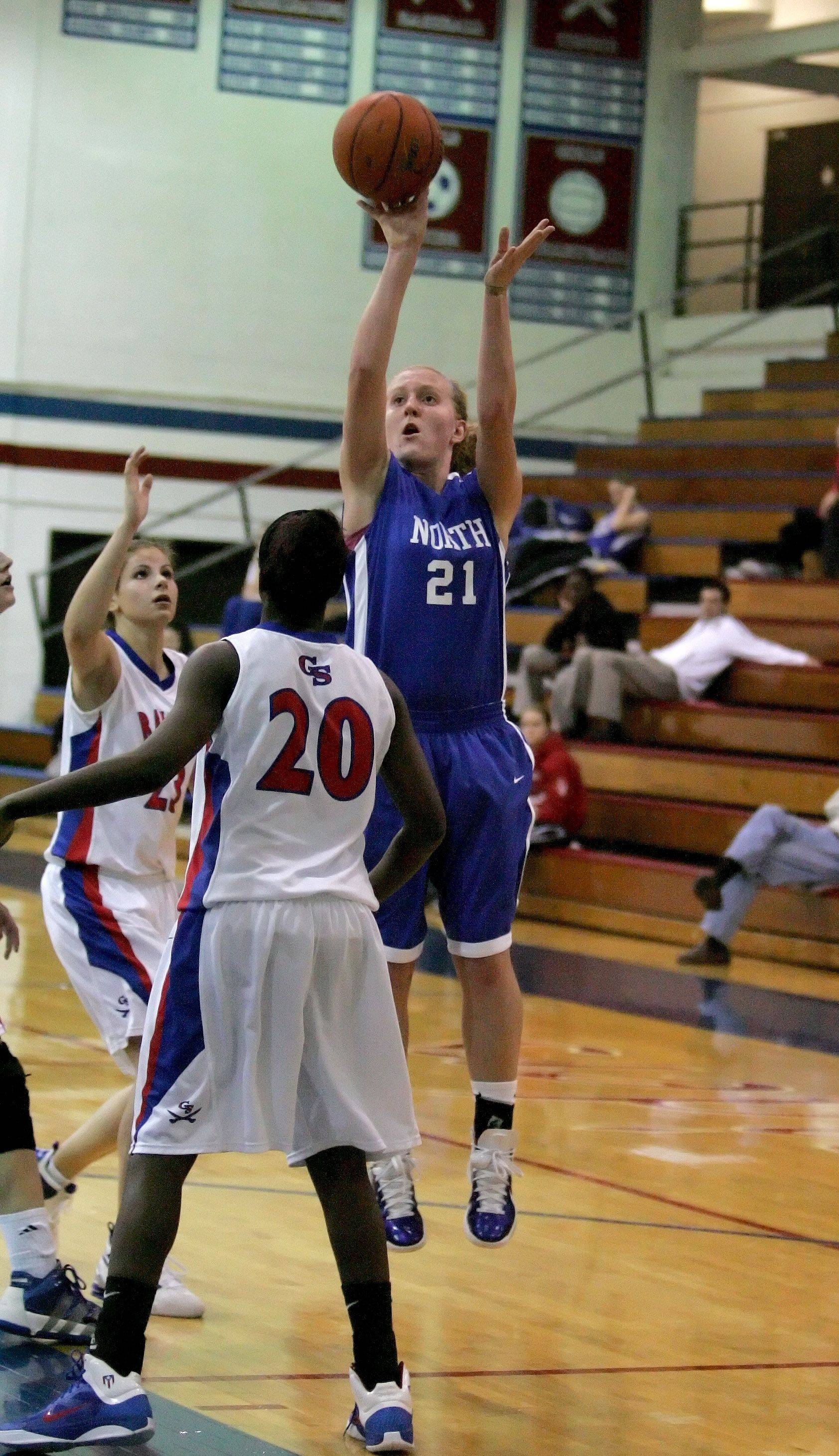Lauren Graham of Wheaton North makes a shot over Patrice Hicks of Glenbard South.