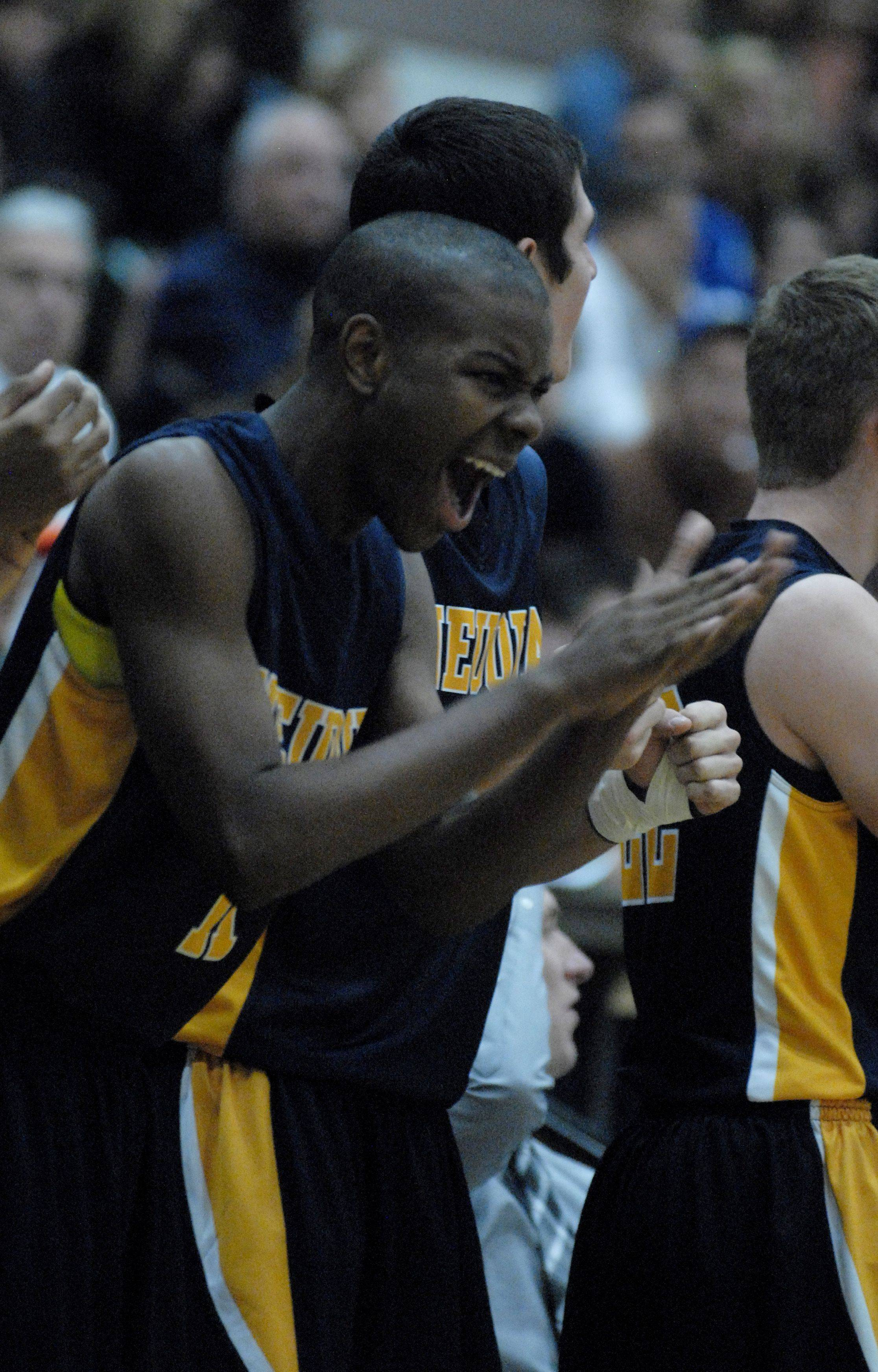 Peter Catchings of Neuqua Valley reacts to the action on the court at St. Charles North High School.