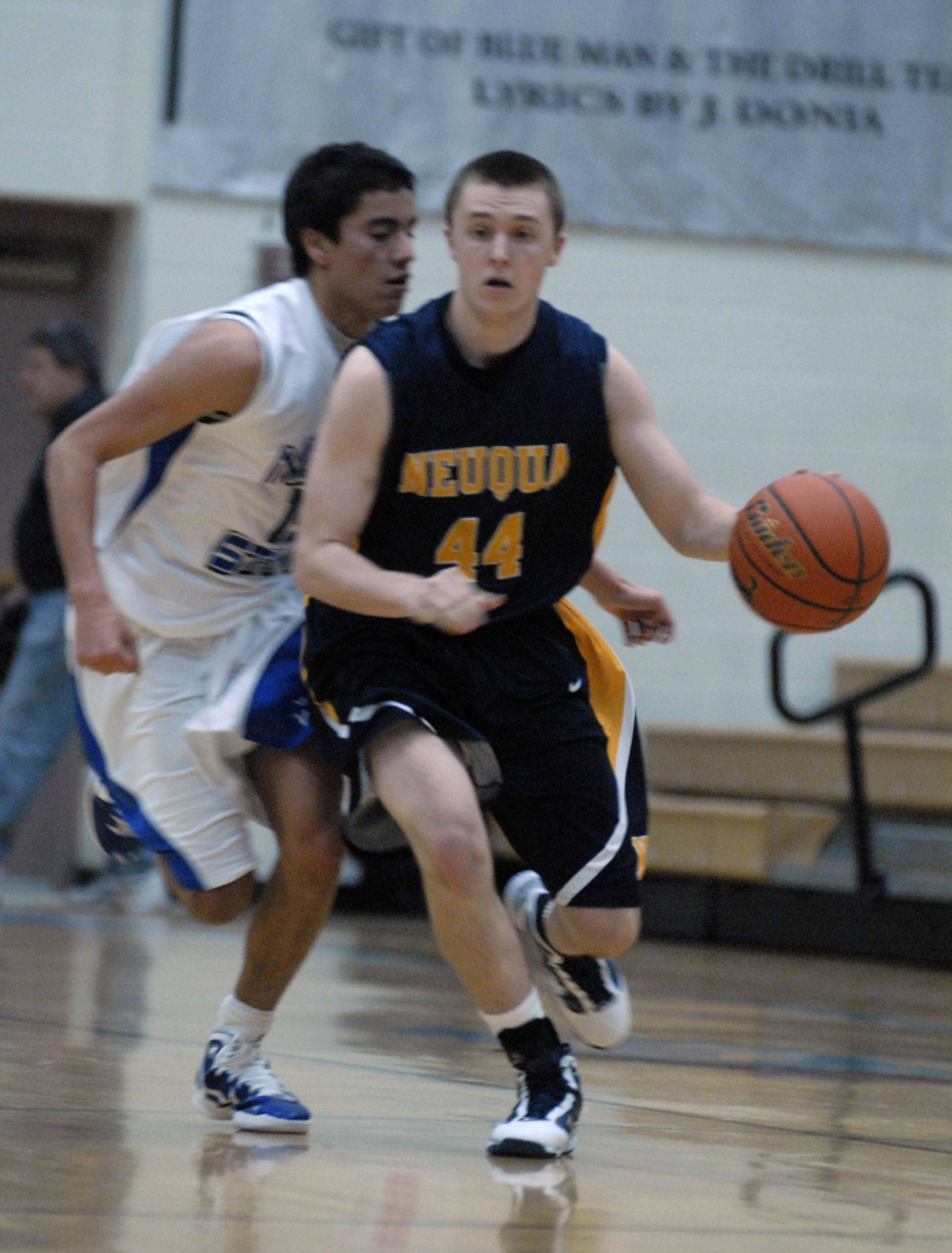 Sean Pyritz of Neuqua Valley checks looks for an open teammate while St. Charles North's Tony Neari chases .