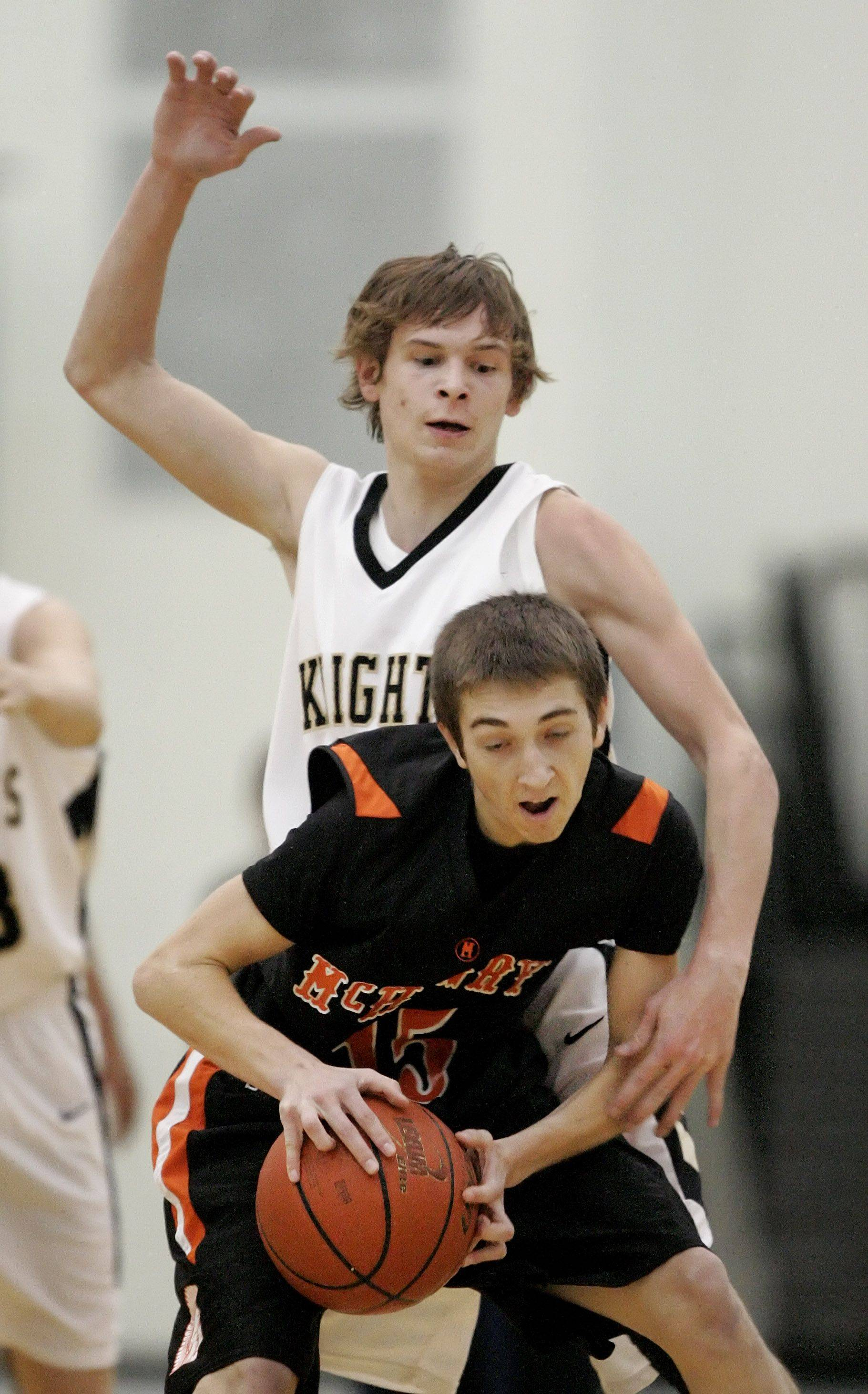 Grayslake North's Teddy Ludwick defends against McHenry's Danny Glick.