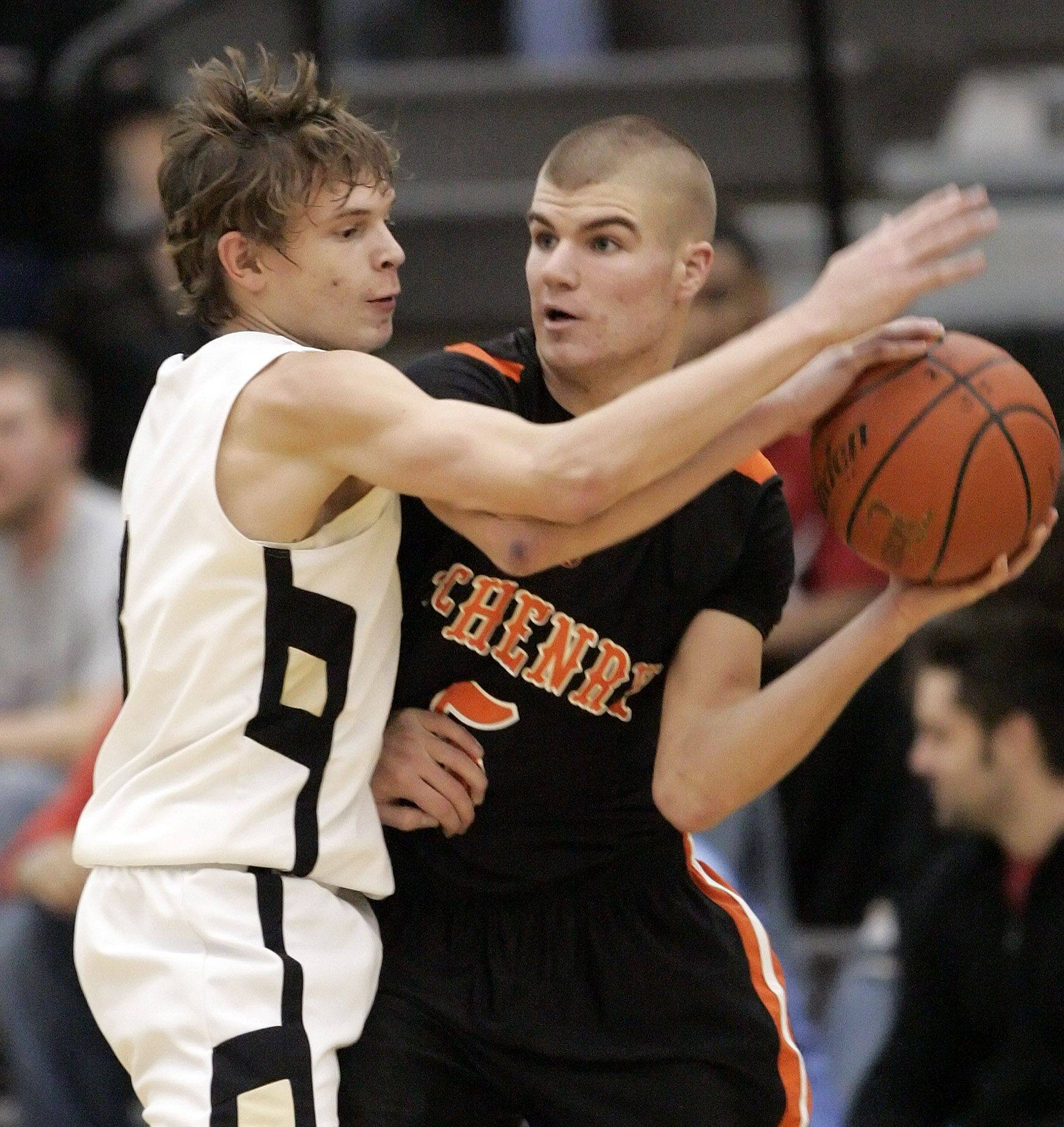 Grayslake North's Teddy Ludwick defends against McHenry's Pat Maher.