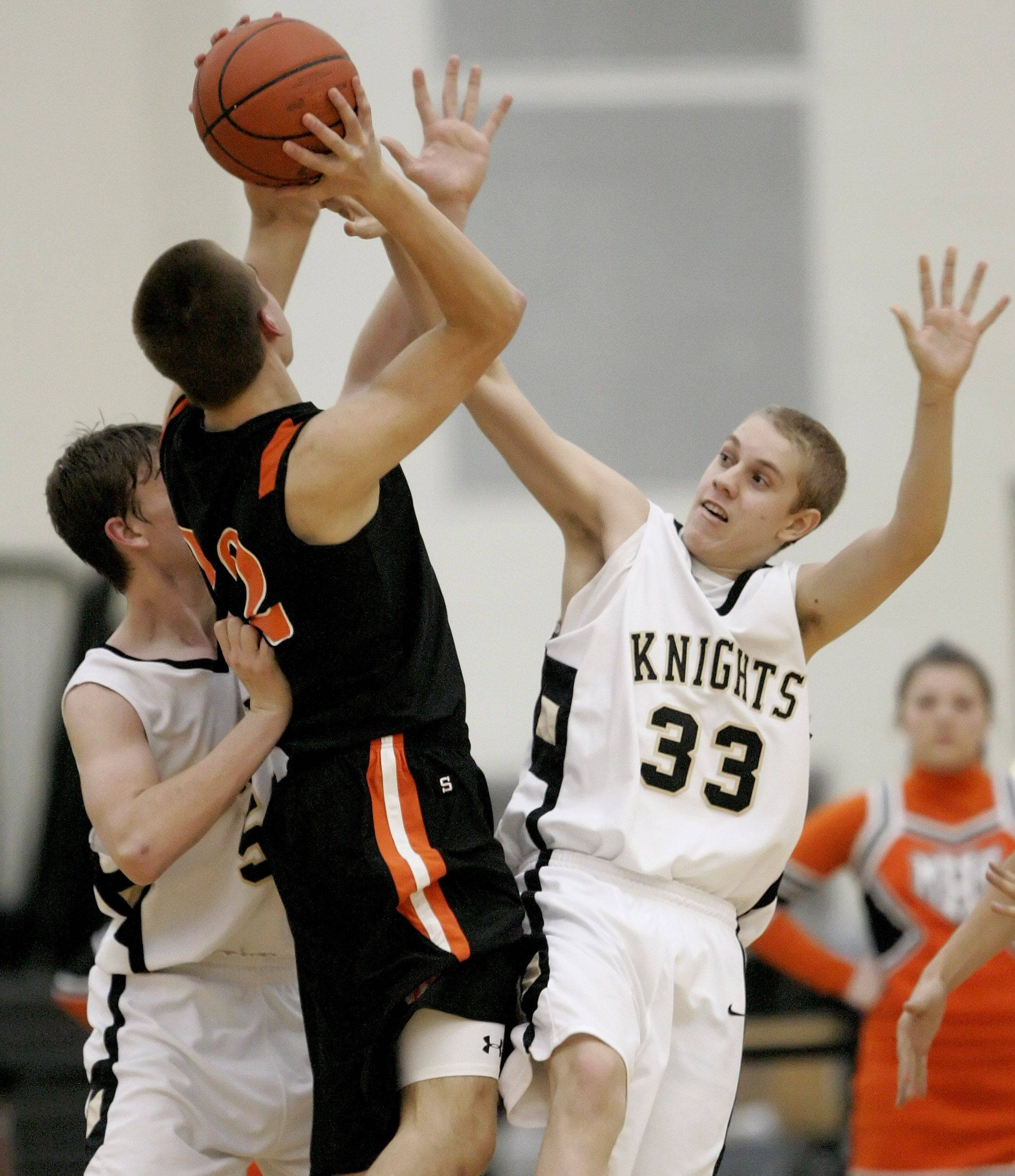 Grayslake North's David Sparks, left and Jake Buckels defend against McHenry's Jamie Rammel.