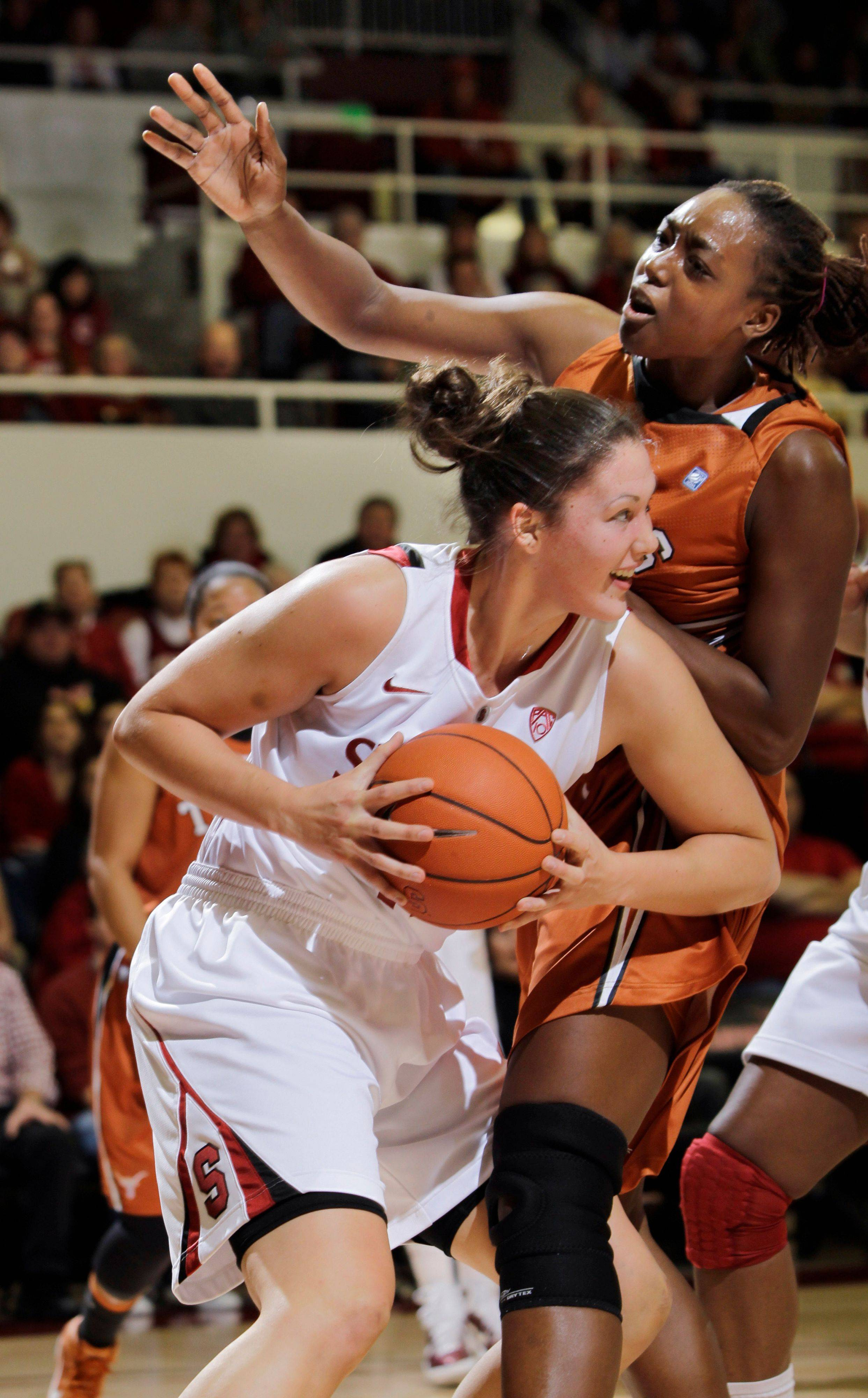 Stanford's Sarah Boothe, a 6-5 center from Warren Township High School, tries to get past Texas forward Ashley Gayle.