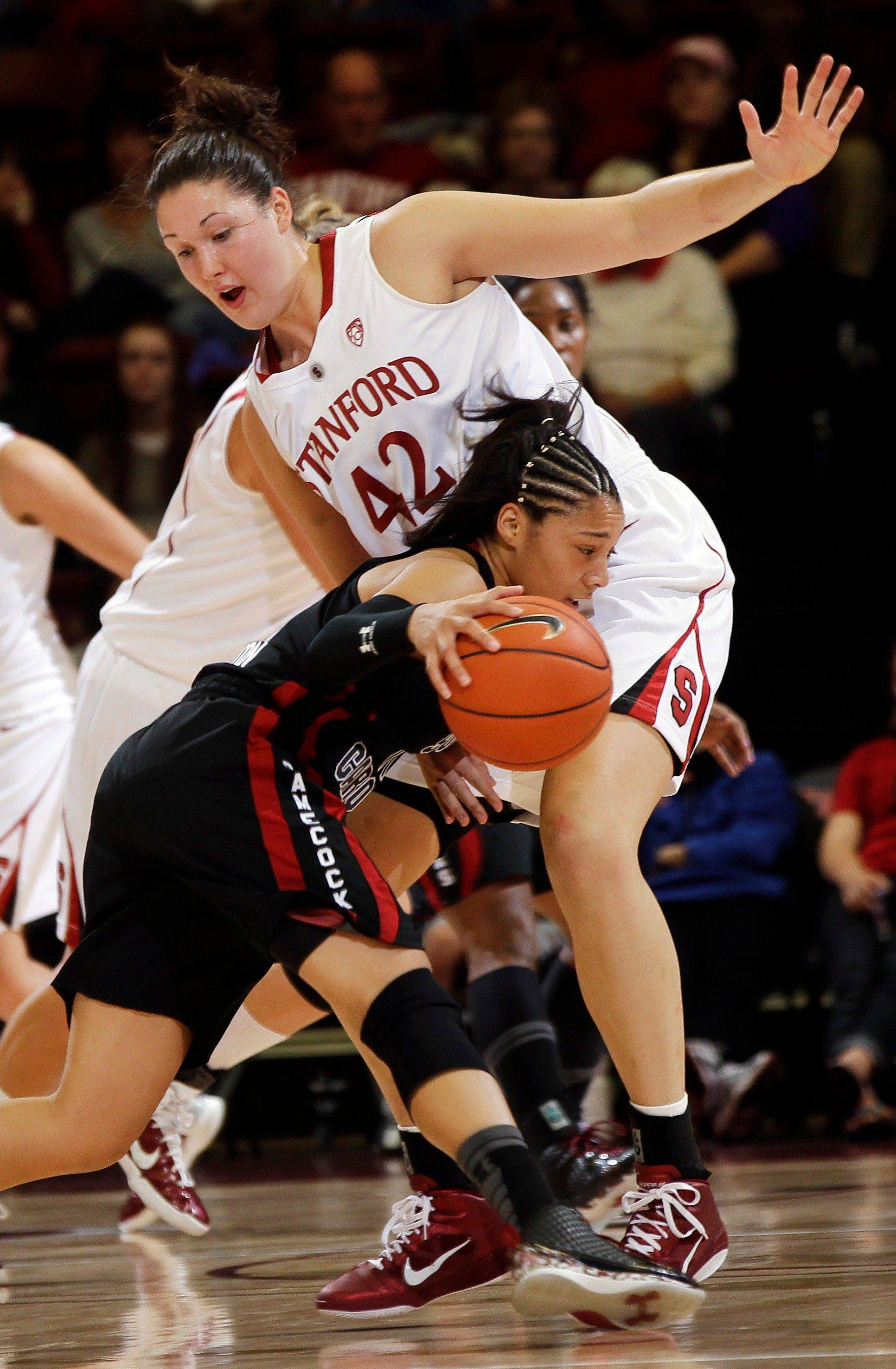 South Carolina guard La'Keisha Sutton tries to dribble around Stanford forward Sarah Boothe, a red-shirt sophomore who is averaging 8 points and 5 rebounds for the Cardinal.