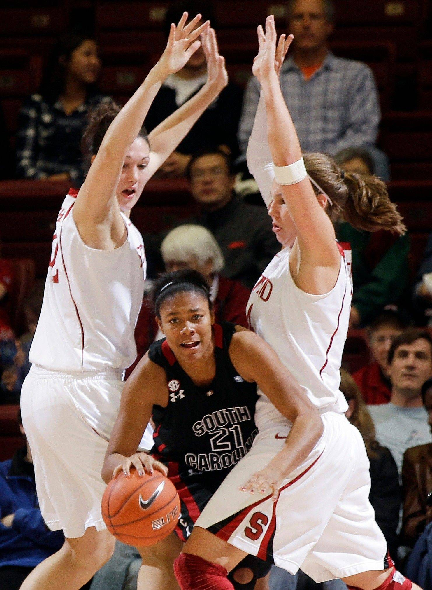 South Carolina forward Ashley Bruner, center, is defended by Stanford forward Sarah Boothe, left, and Kayla Pedersen as the Cardinal crushed South Carolina 70-32 last month. Boothe is a former All-Area captain for the Daily Herald. and the first person off the bench for Stanford, which plays at DePaul on Thursday.