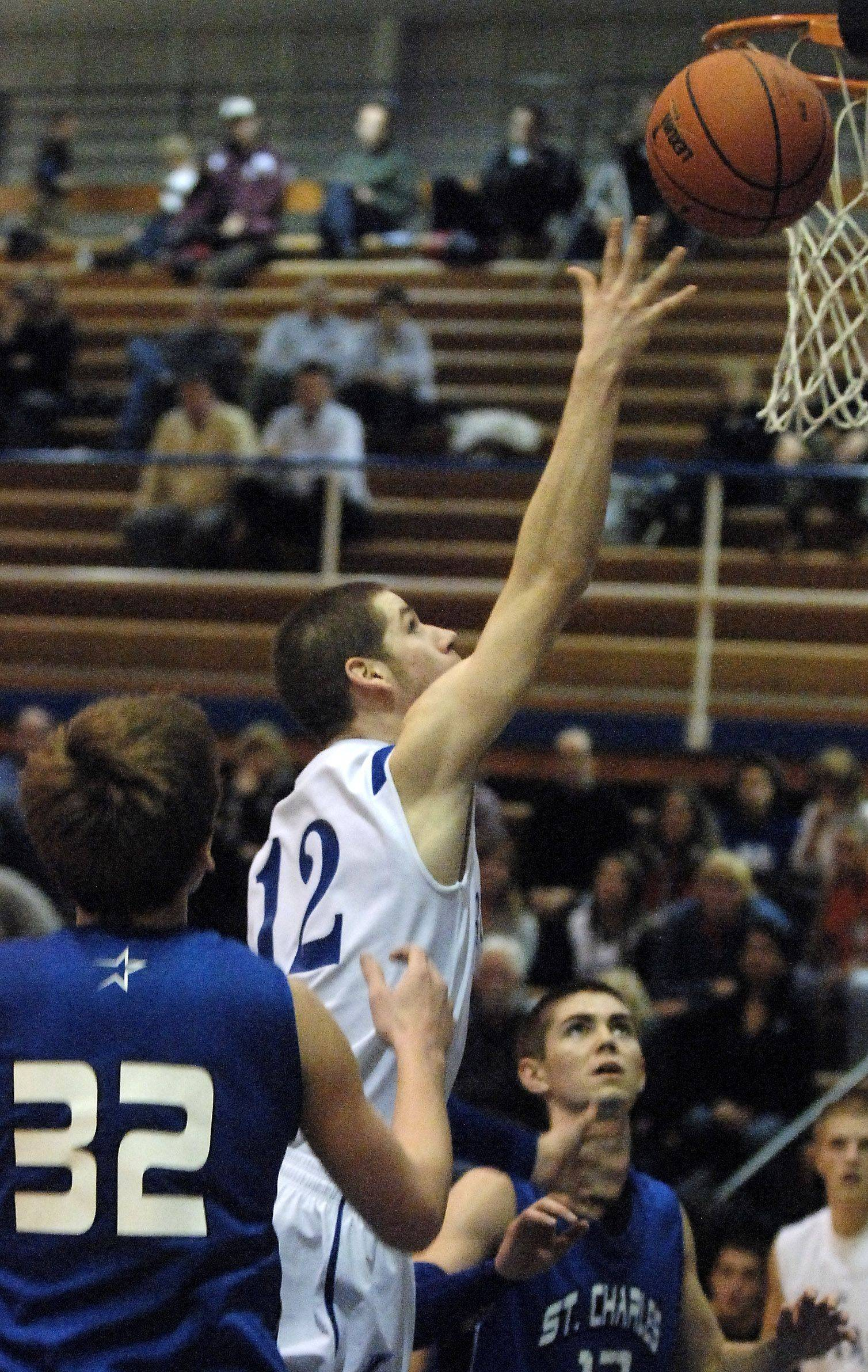 Larkin's Ian Fluhler goes to the rim against St. Charles North.