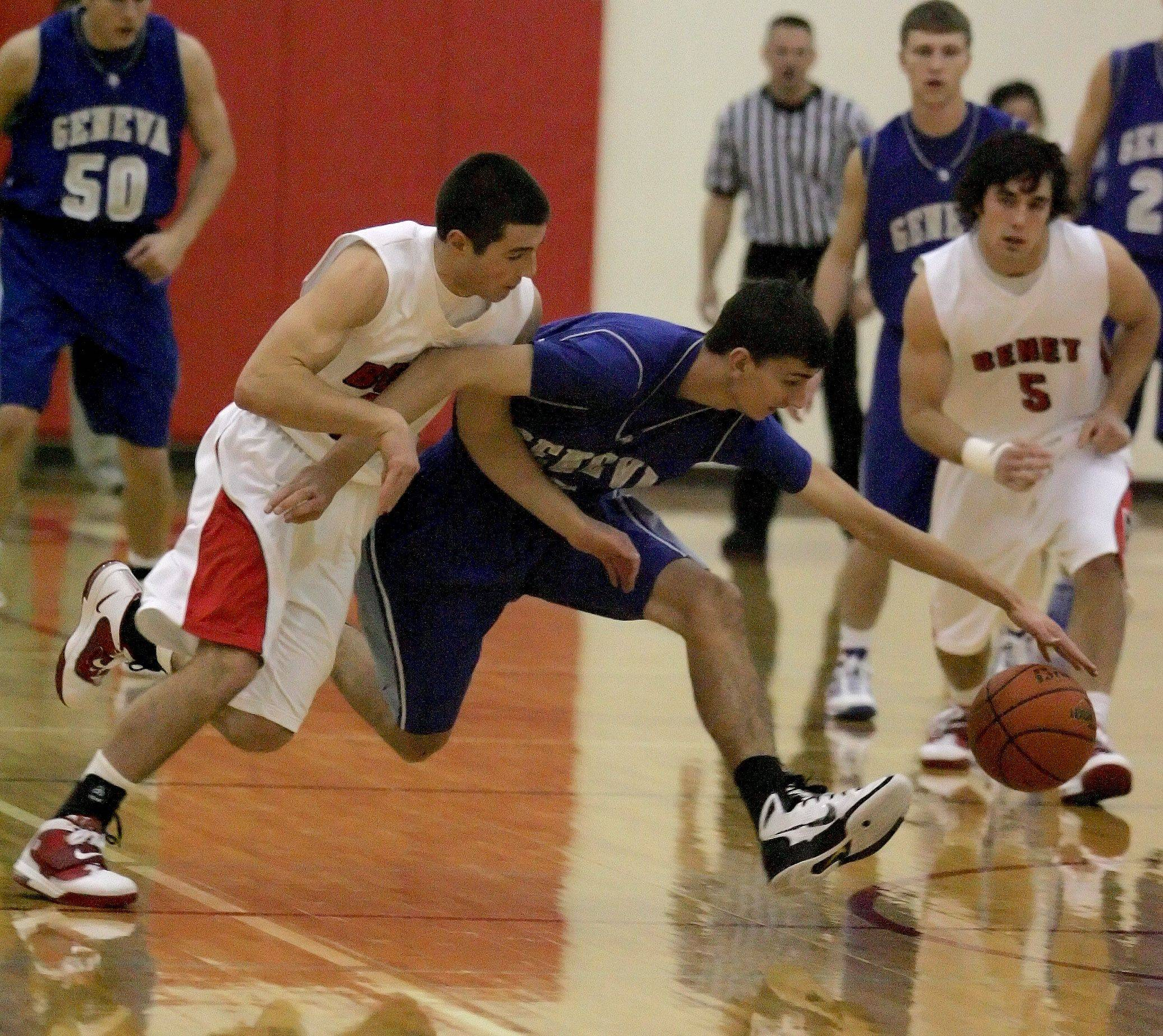 Matt Parisi of Benet, left, and Brendan Leahy, right of Geneva, chase after a loose ball during boys basketball at the Plainfield North Holiday Tournament on Friday.