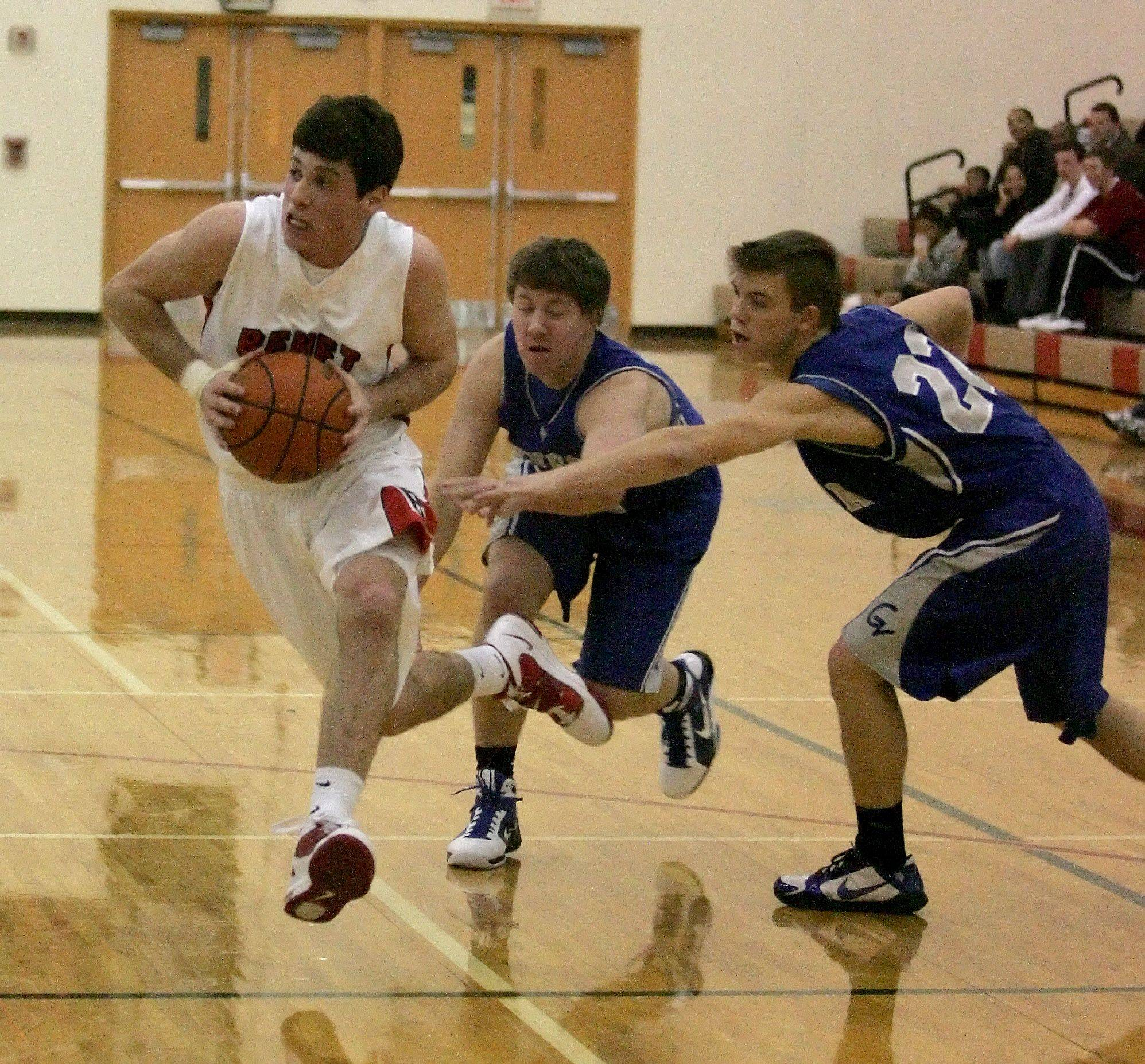 Dave Sobolewski of Benet, left, eludes John Swiderski, center and Ryan Willing, right, of Geneva in boys basketball action at the Plainfield North Holiday Tournament on Friday.