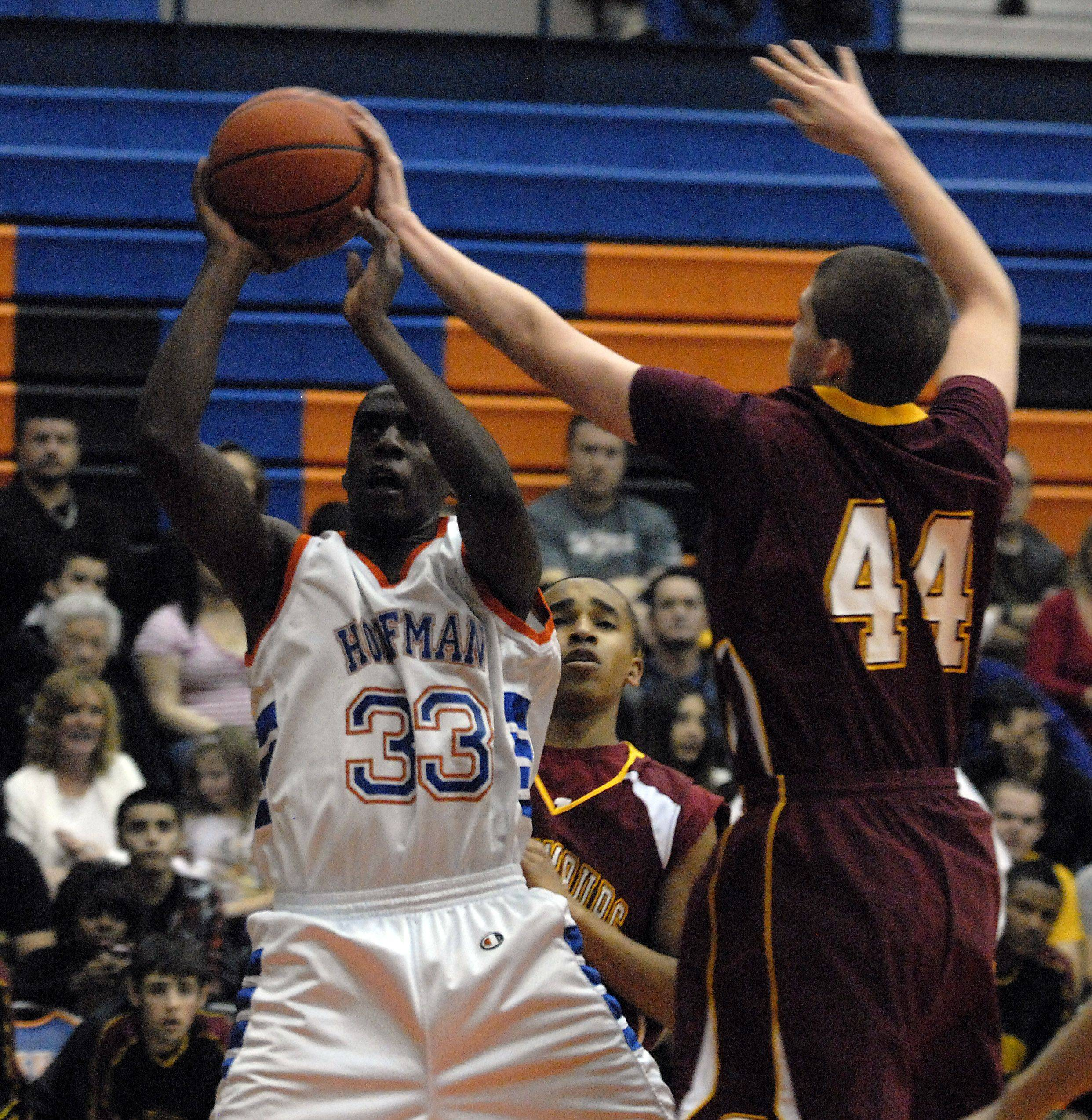 Schaumburg's Jimmy Lundquist goes against Hoffman Estates' Austin Terry in the first half.