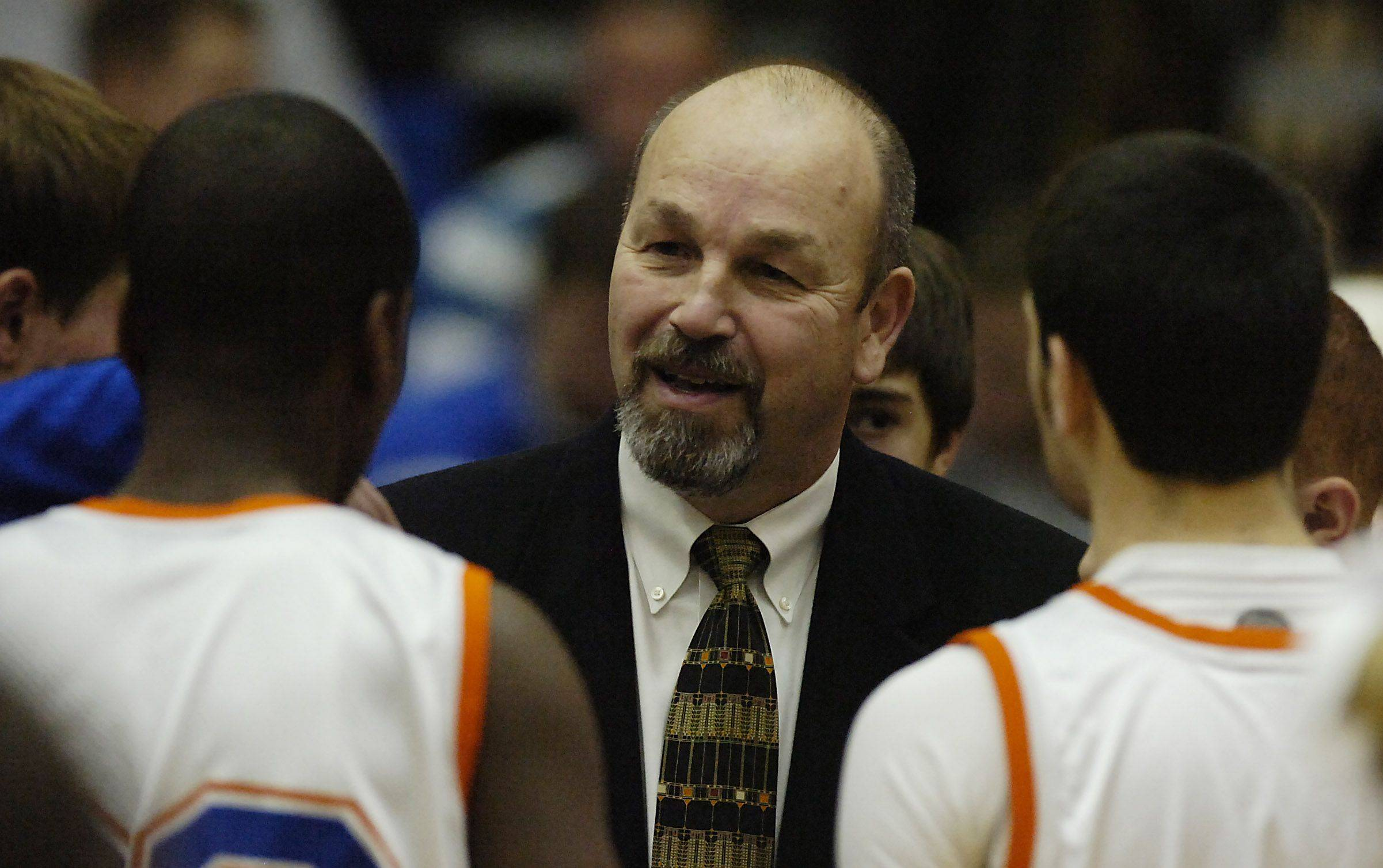 Hoffman Estates' boys basketball head coach Bill Wandro talks to his players.