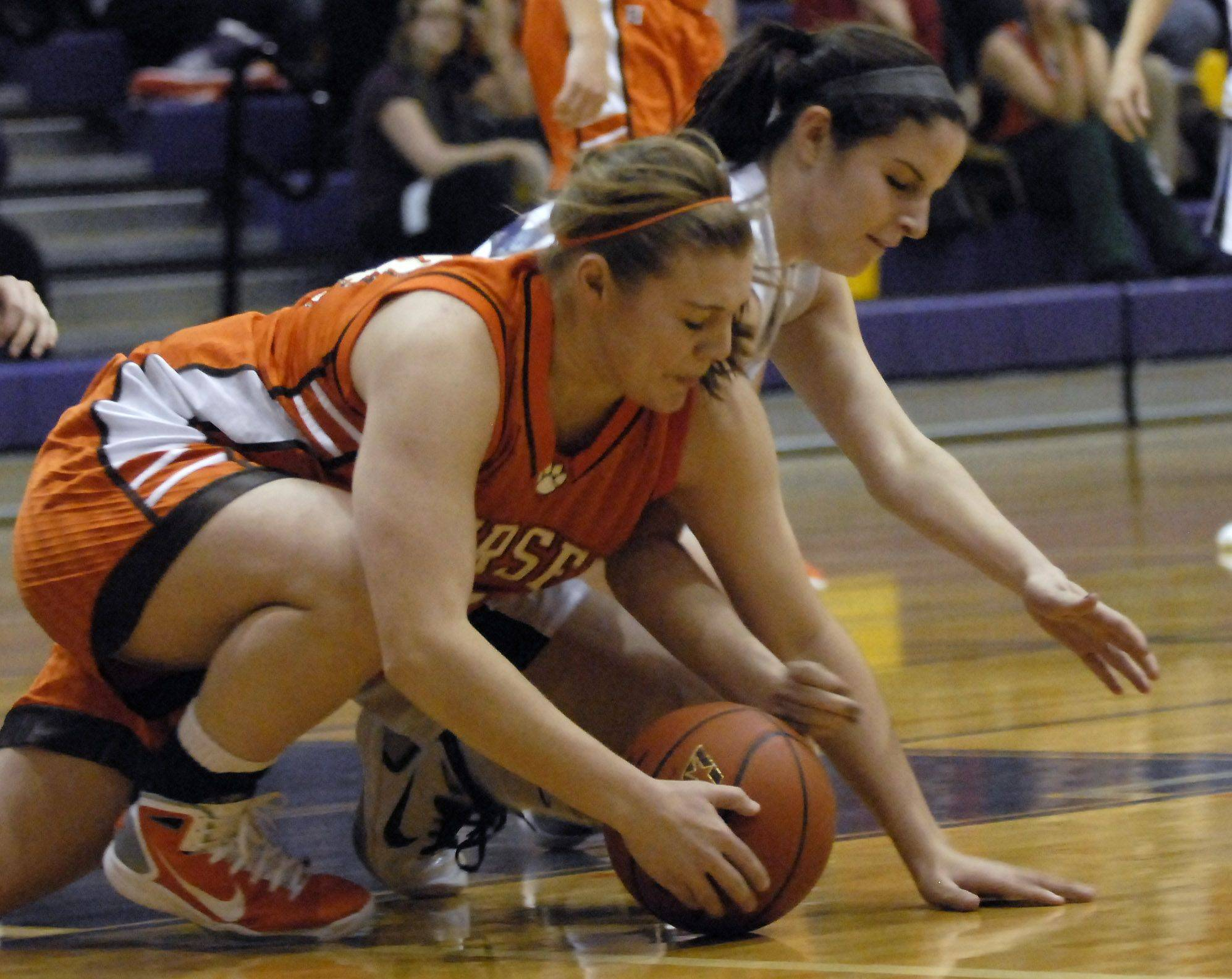 Hersey's Eileen Zydek and Rolling Meadows' Ann Marie Lynch battle for the ball.