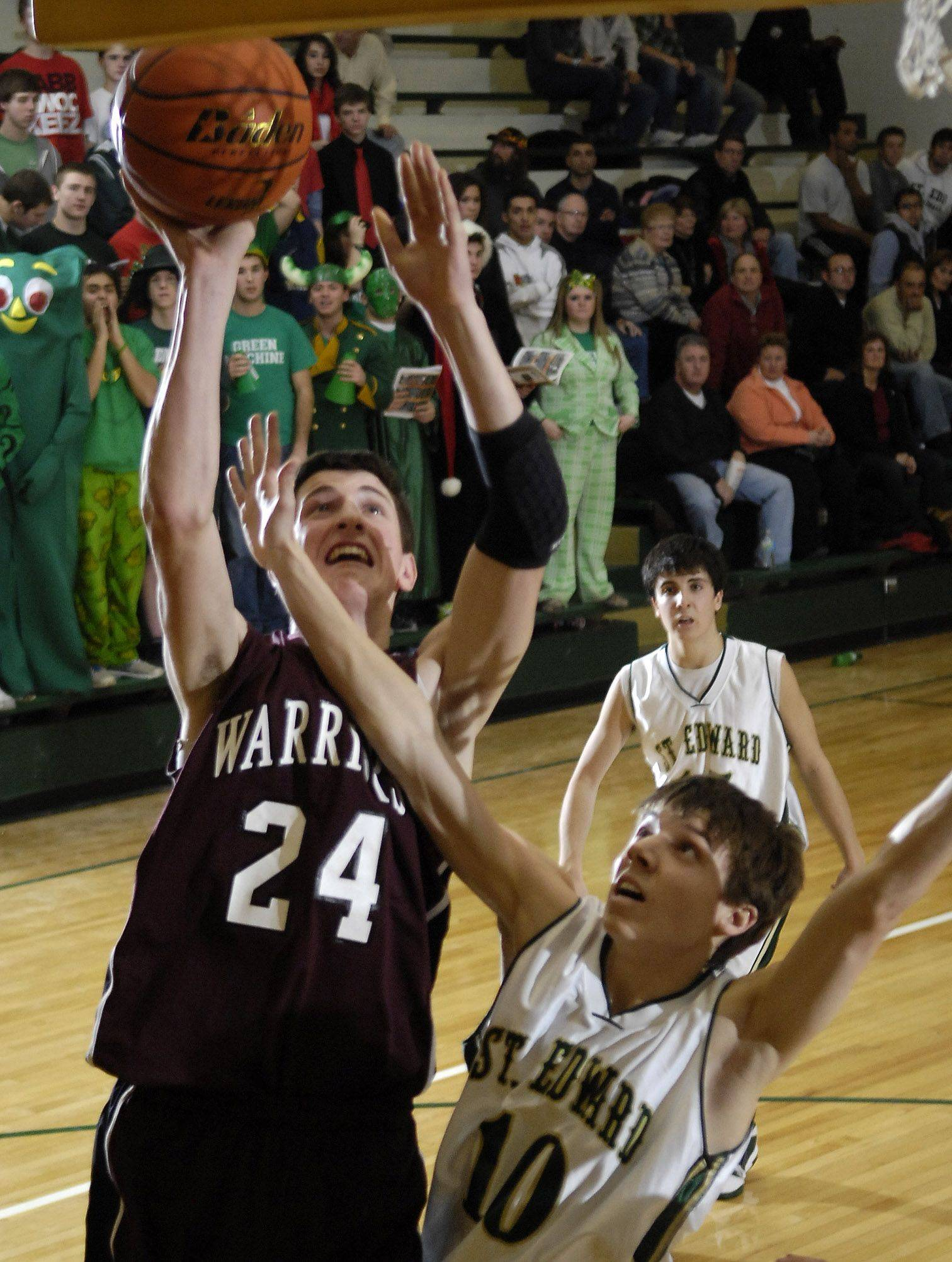 Wheaton Academy's Luke Thorson puts up a shot over St. Edward's Zach Brewster .