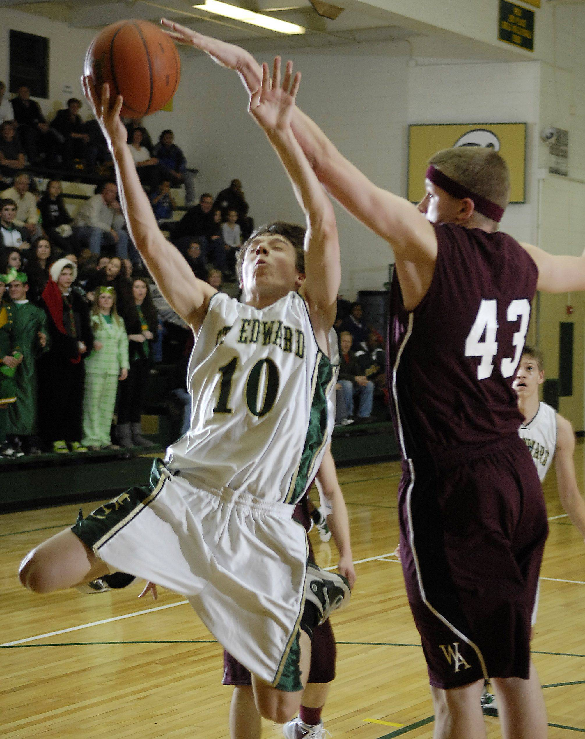 St. Edward's Zach Brewster has his shot blocked by Wheaton Academy's Luke Johnson.