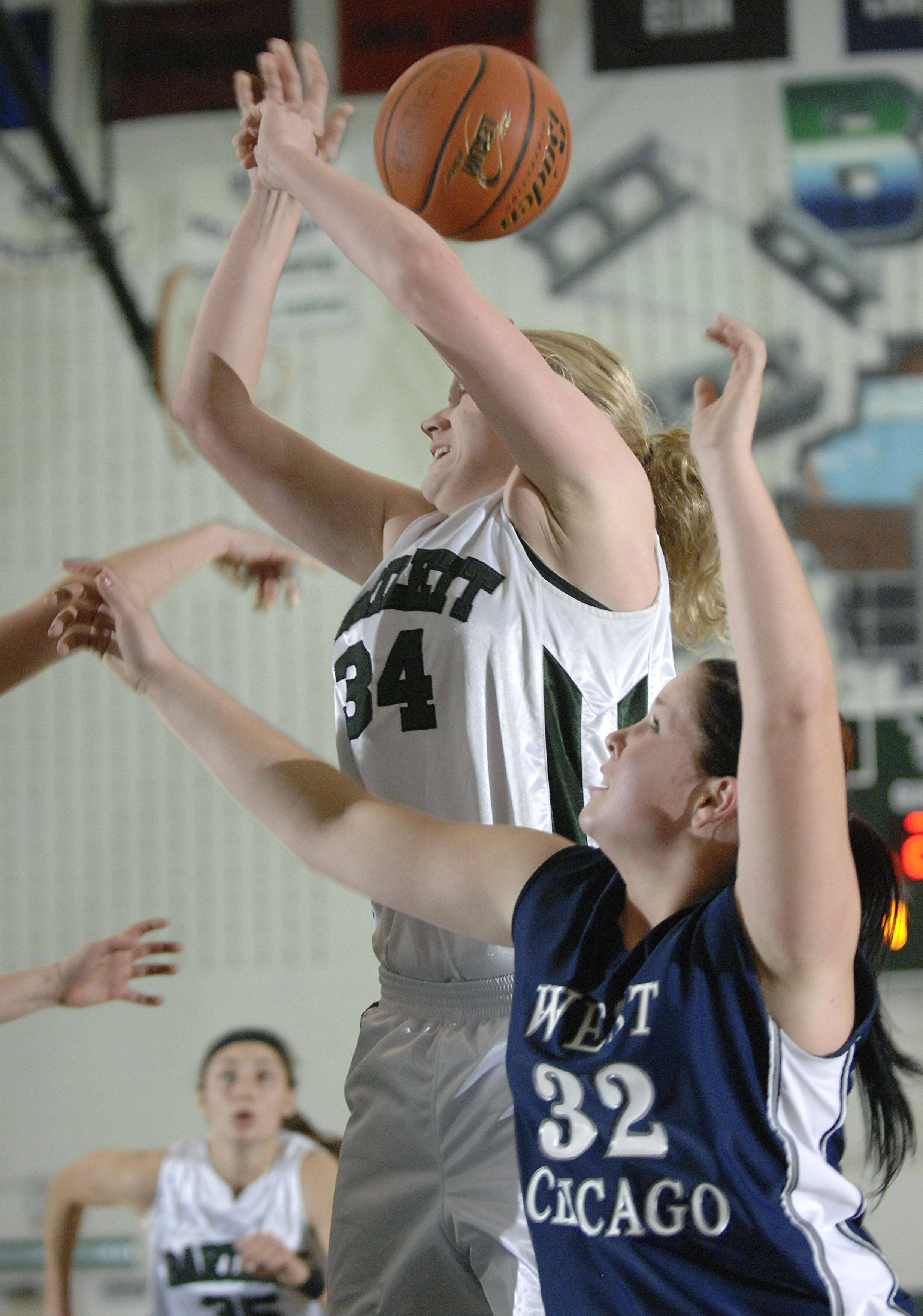 Bartlett's Christina Carlson is fouled by West Chicago's Kelsey Myers in the second quarter on Saturday, December 18.