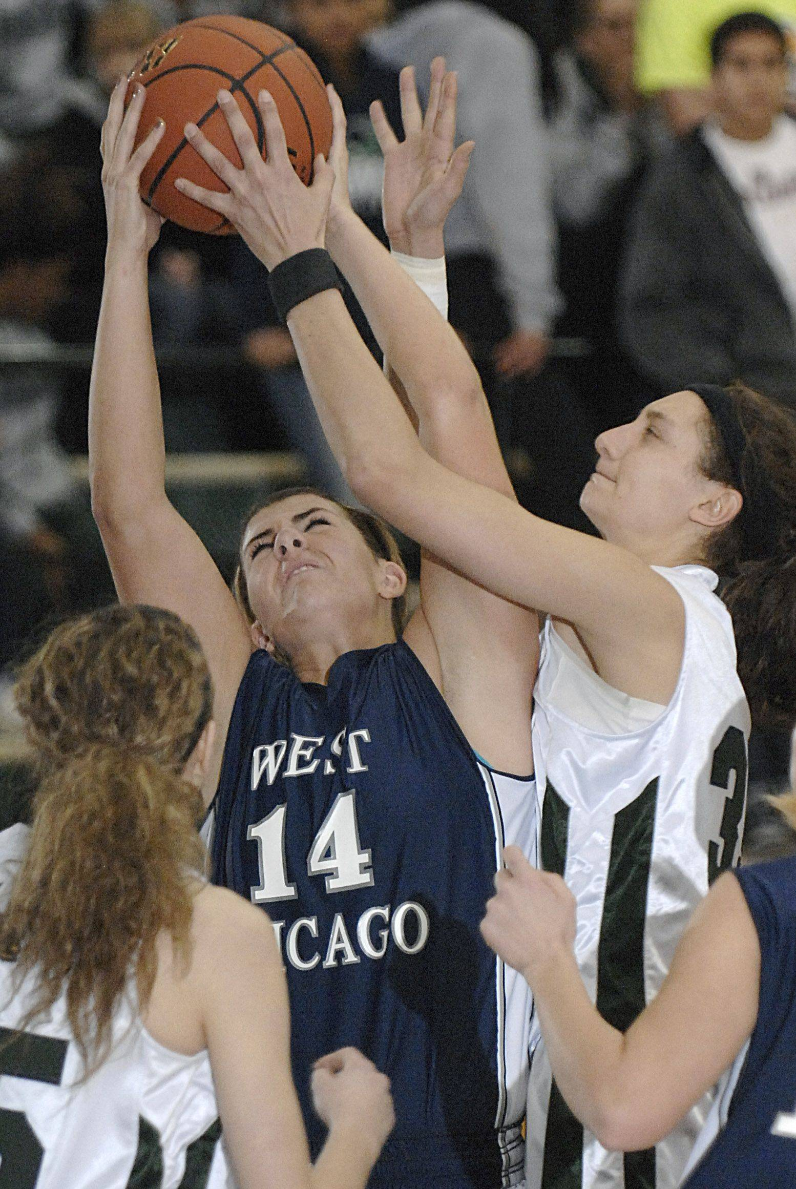 Bartlett's Jacki Gulczynski denies West Chicago's Mary Connolly a shot in the fourth quarter.