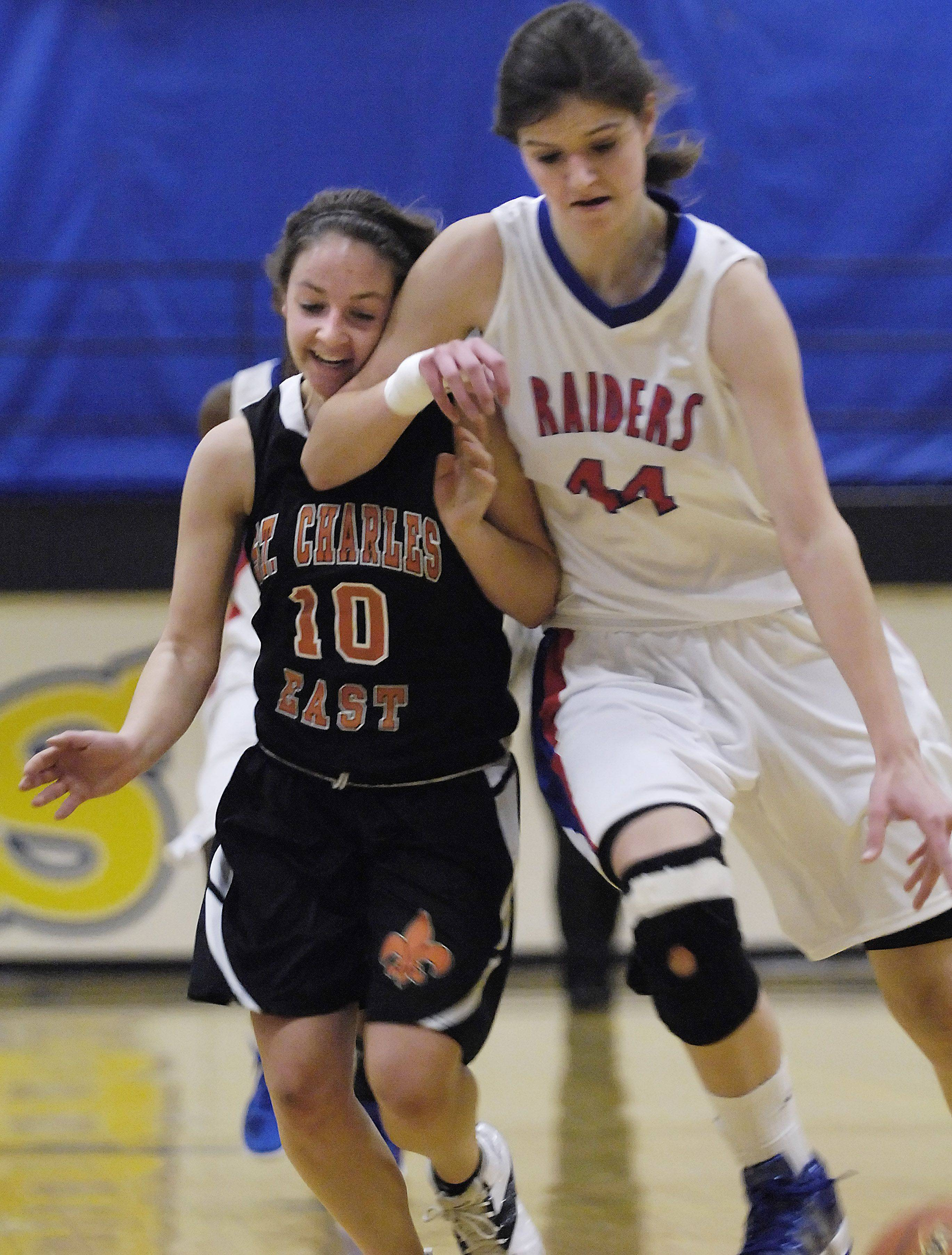 Glenbard South's Nevena Markovic drives against St. Charles East's Annie Martines.