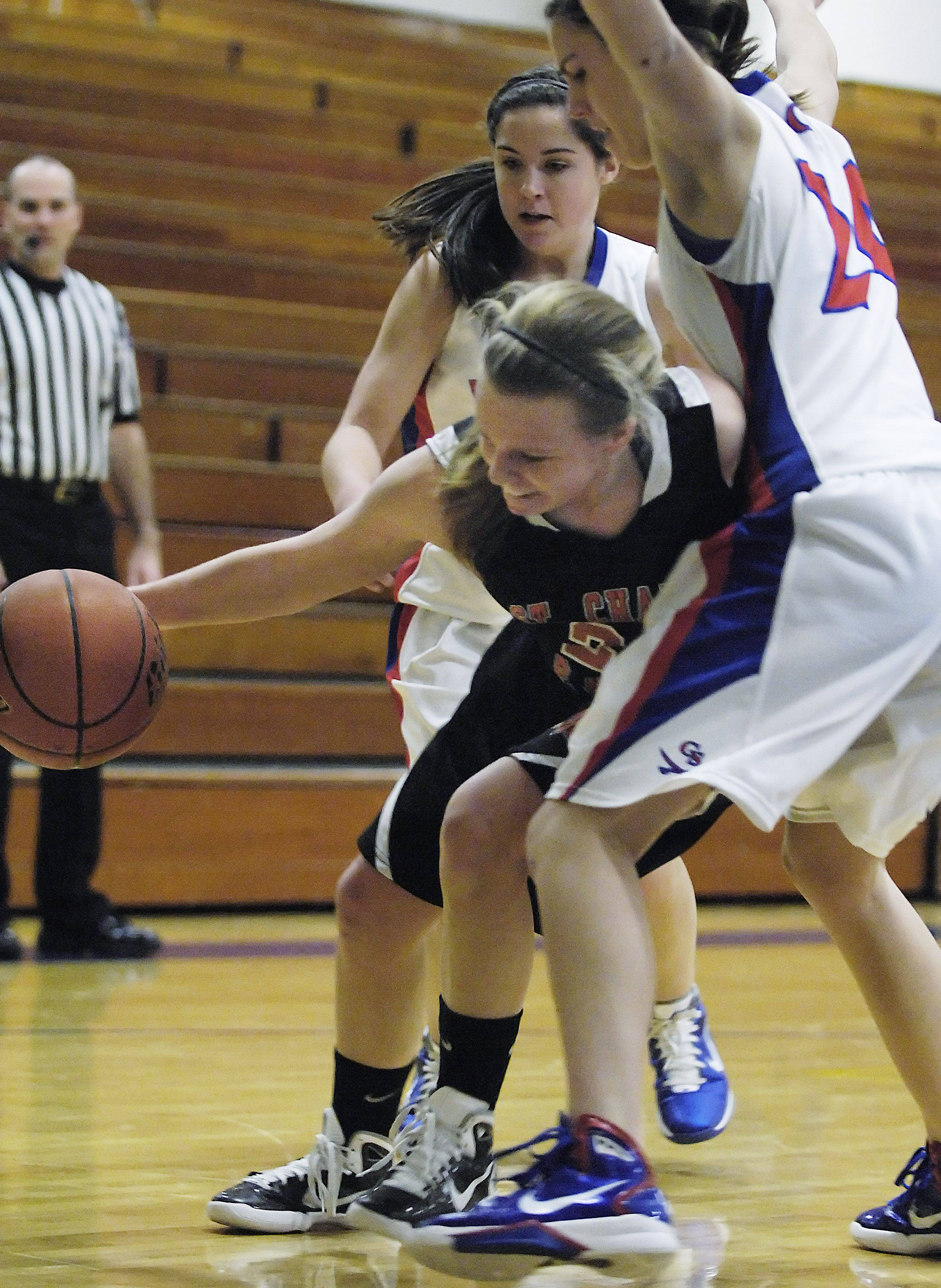 St. Charles East's Amanda Hilton controls the ball under the basket against Glenbard South's Danielle Chitkowski and Alyse Cates.