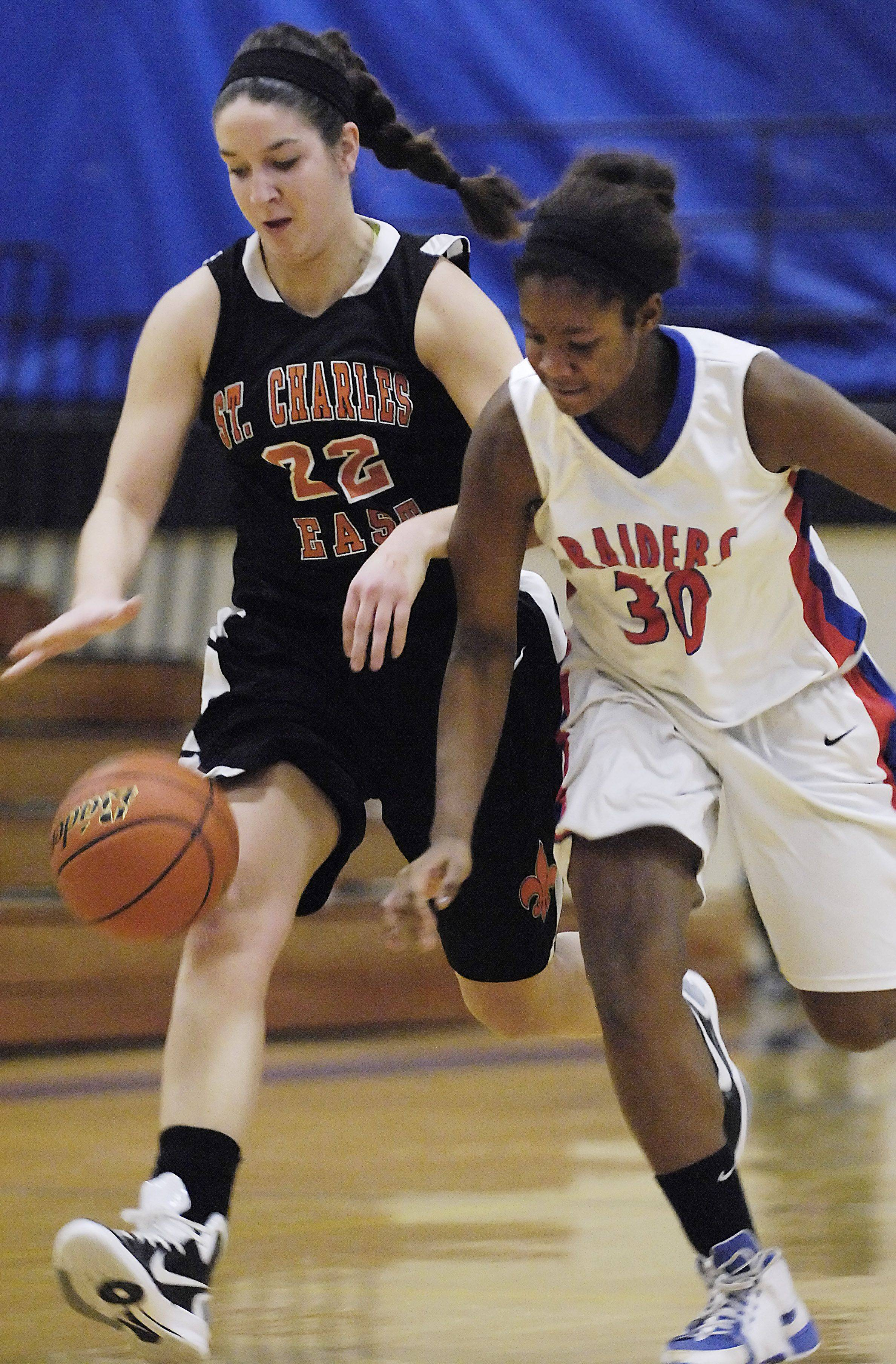 St. Charles East's Dani Asquini and Glenbard South's Hannah Davey chase a loose ball.
