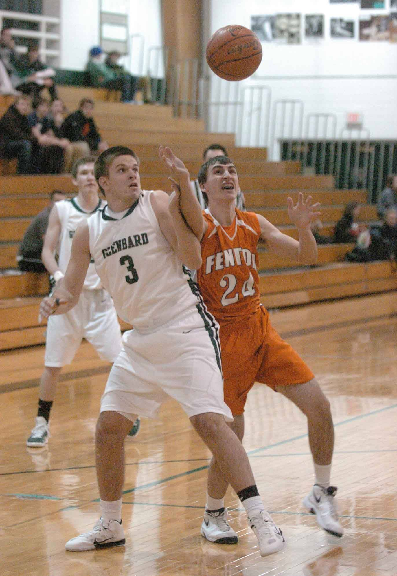 Evan Fischl,left, of Glenbard West and Jeremy Shimanek of Fenton during the Fenton at Glenbard West boys basketball game Tuesday.