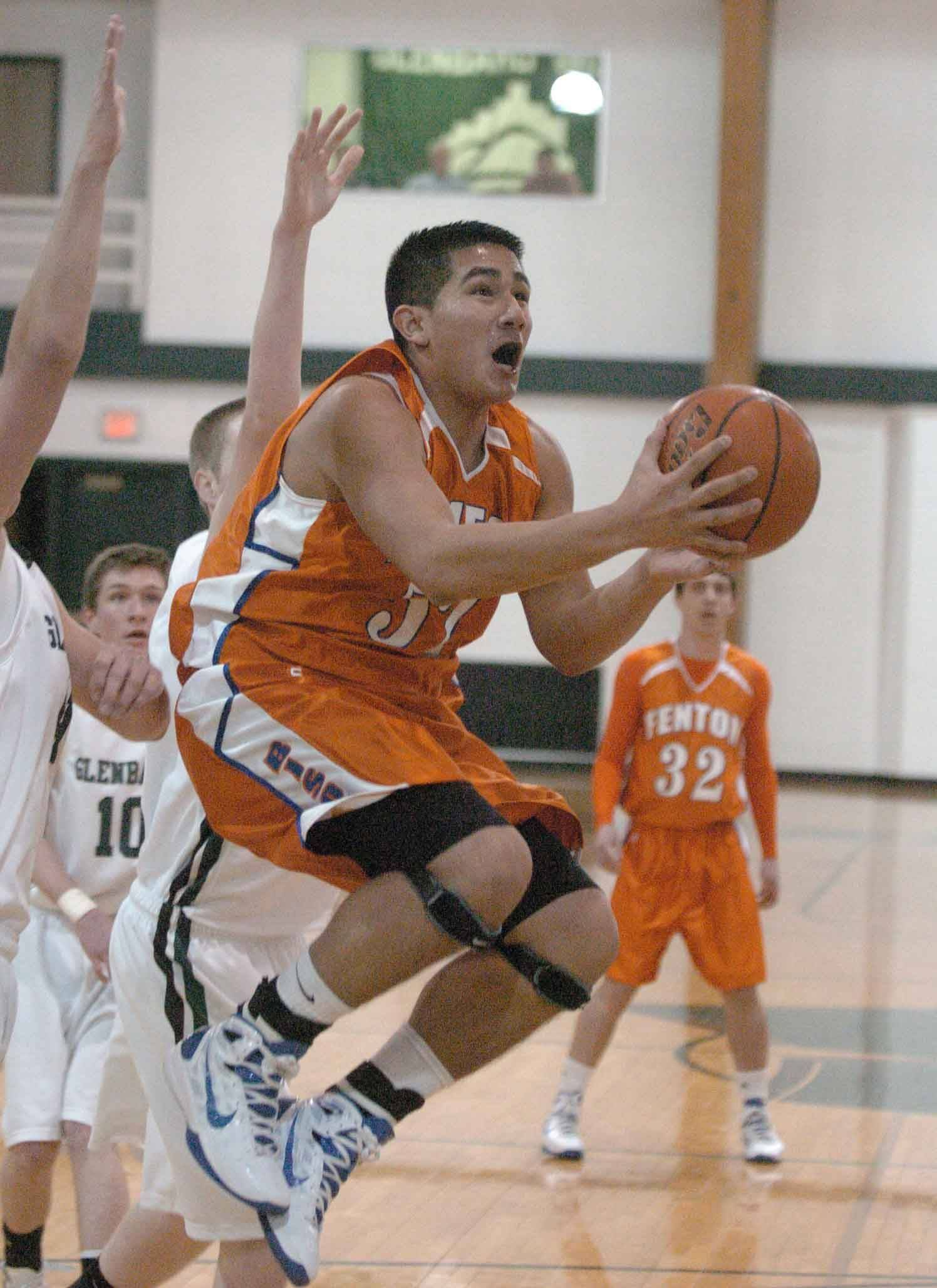 Dan Montano of Fenton takes a shot during the Fenton at Glenbard West boys basketball game Tuesday.