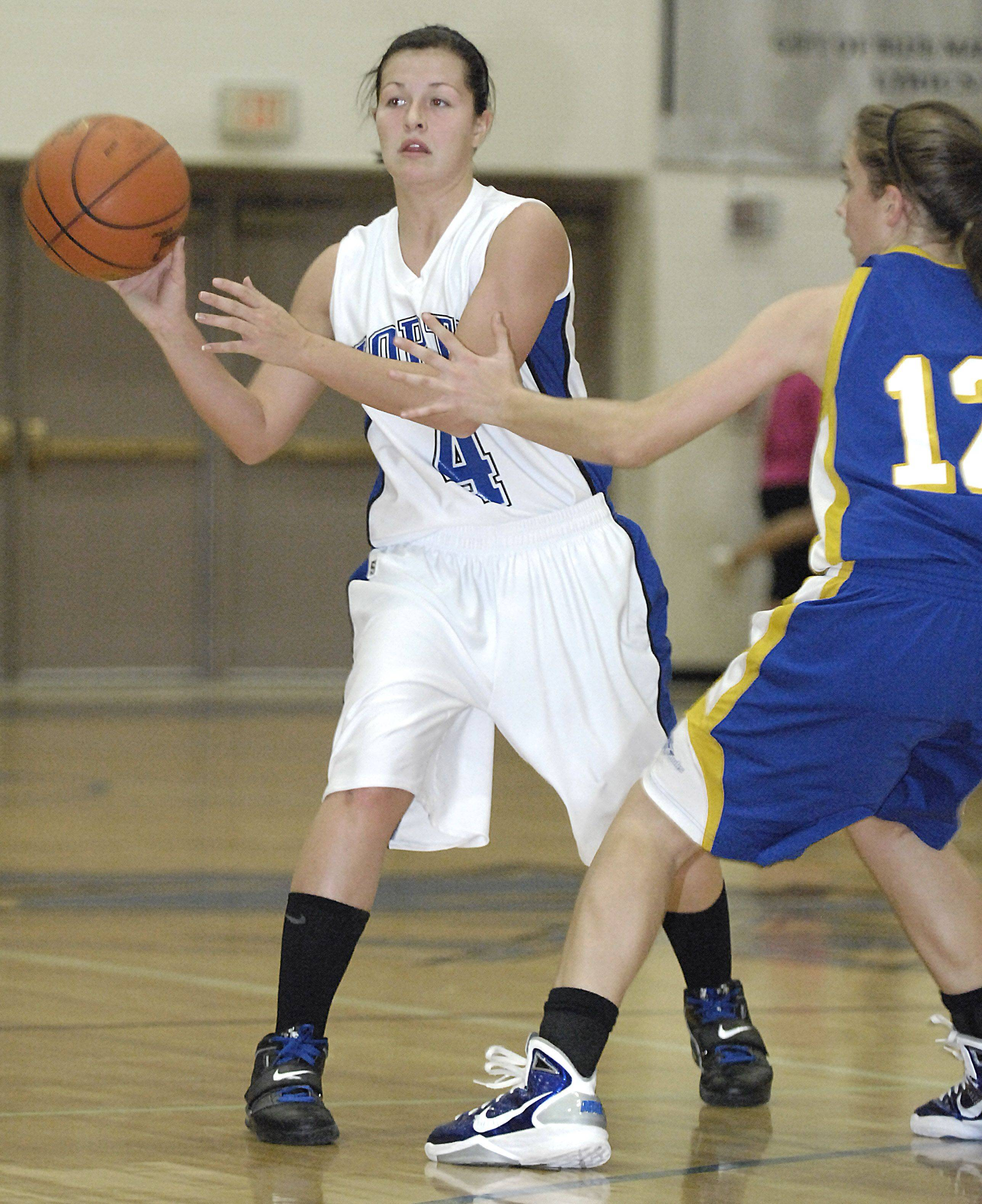 St. Charles North's Sydney Russell passes around Johnsburg's Katie Weingart in the second quarter.