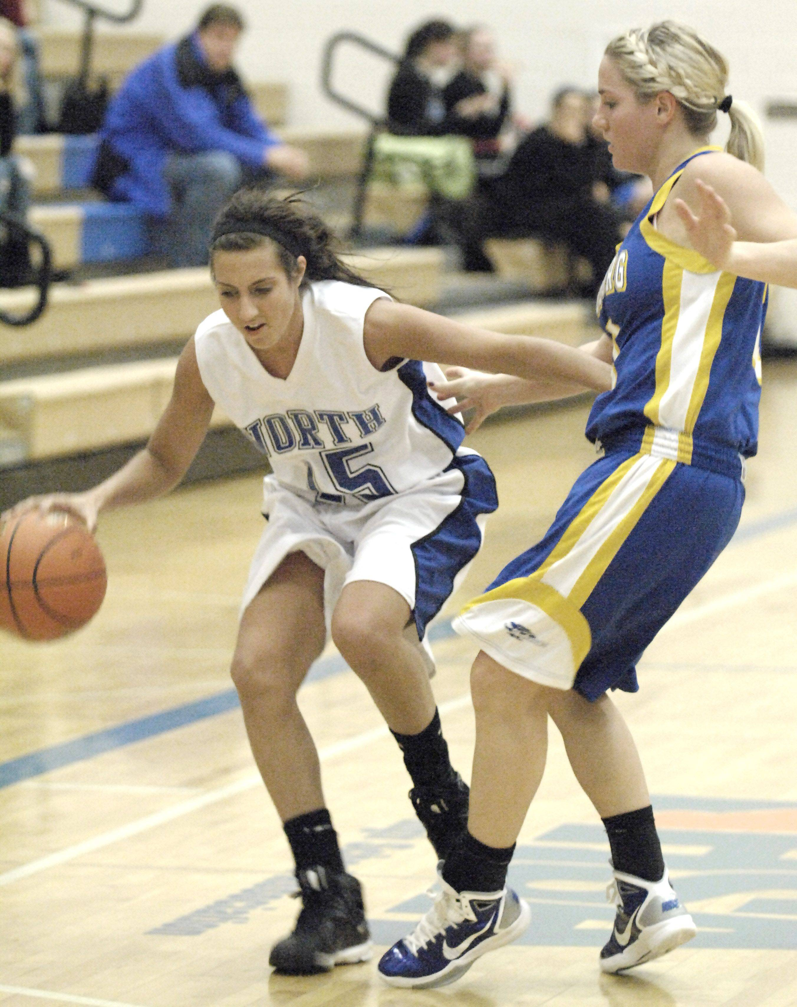 St. Charles North's Natalie Capone keeps Johnsburg's Susan Conroy at bay as she approaches the basket.
