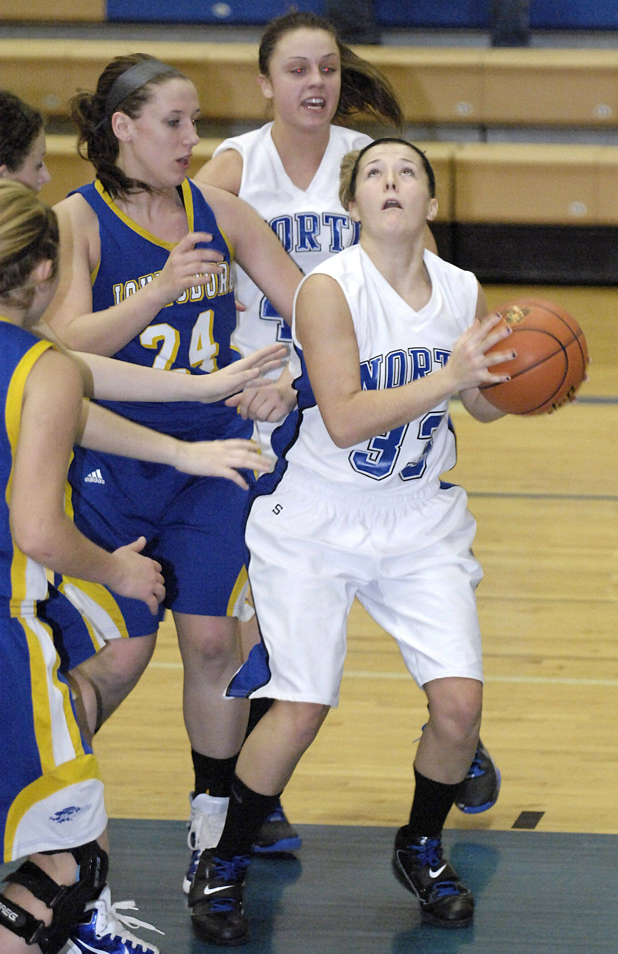 St. Charles North's Taylor Russell grabs a rebound.