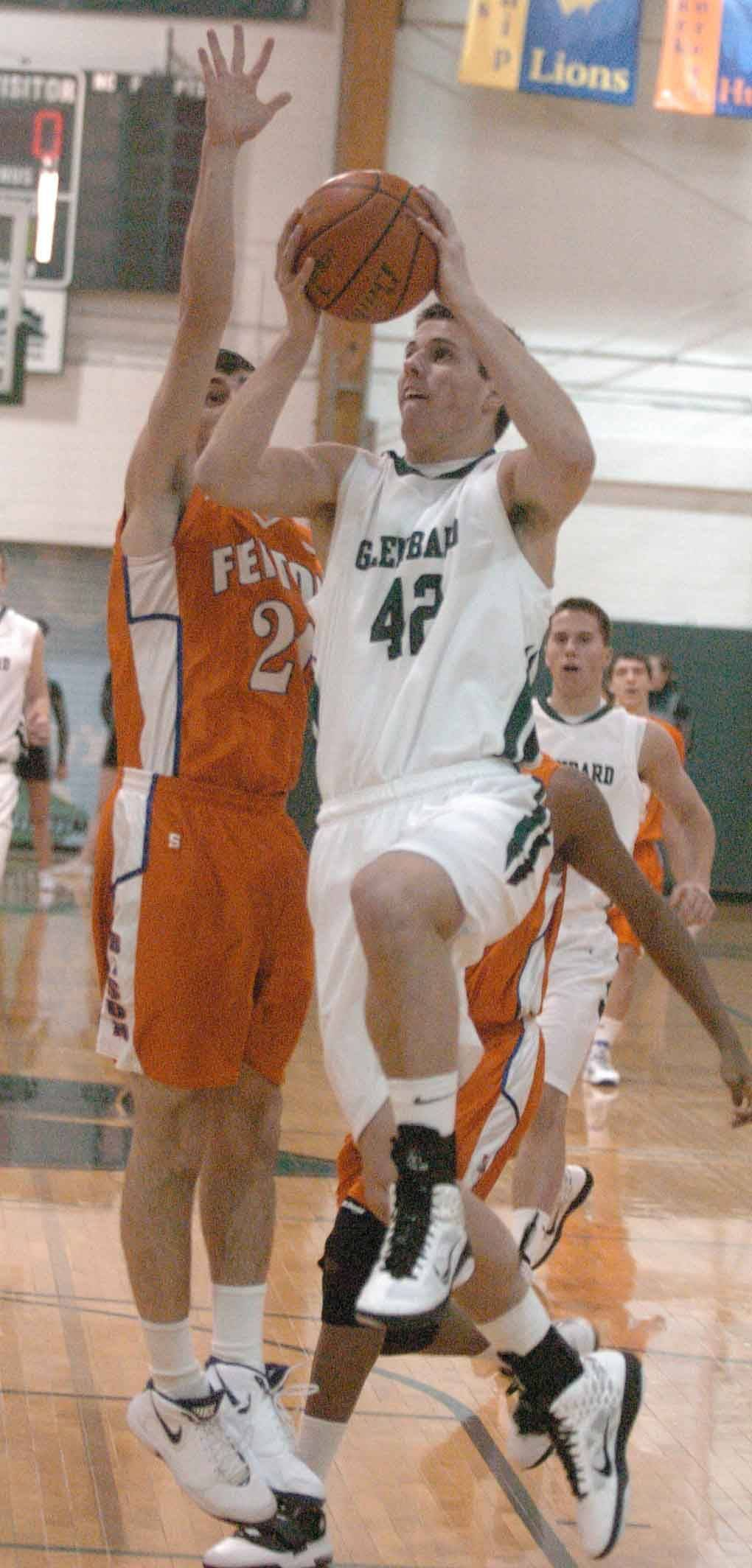 Michael Mache of Glenbard West goes up for a shot against Fenton.