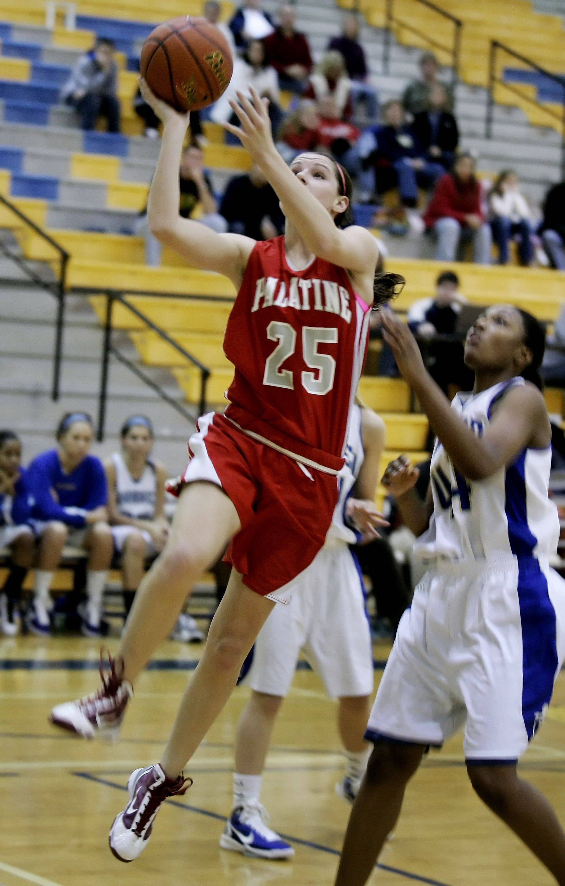 Palatine forward Katelyn Mayer goes up for a layup during the girls basketball game between Palatine and Warren Tuesday in the 2010 Blue Devil Classic at Warren Township High School in Gurnee.