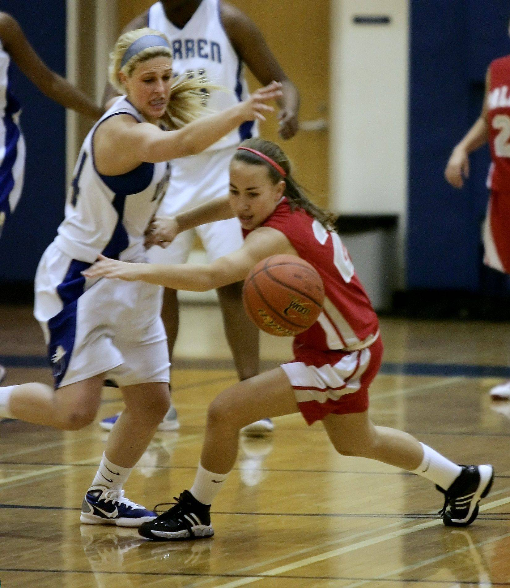 Warren guard Amanda Barger knocks the ball away from Palatine guard Laura Schweikert during the girls basketball game between Palatine and Warren Tuesday in the 2010 Blue Devil Classic at Warren Township High School in Gurnee.