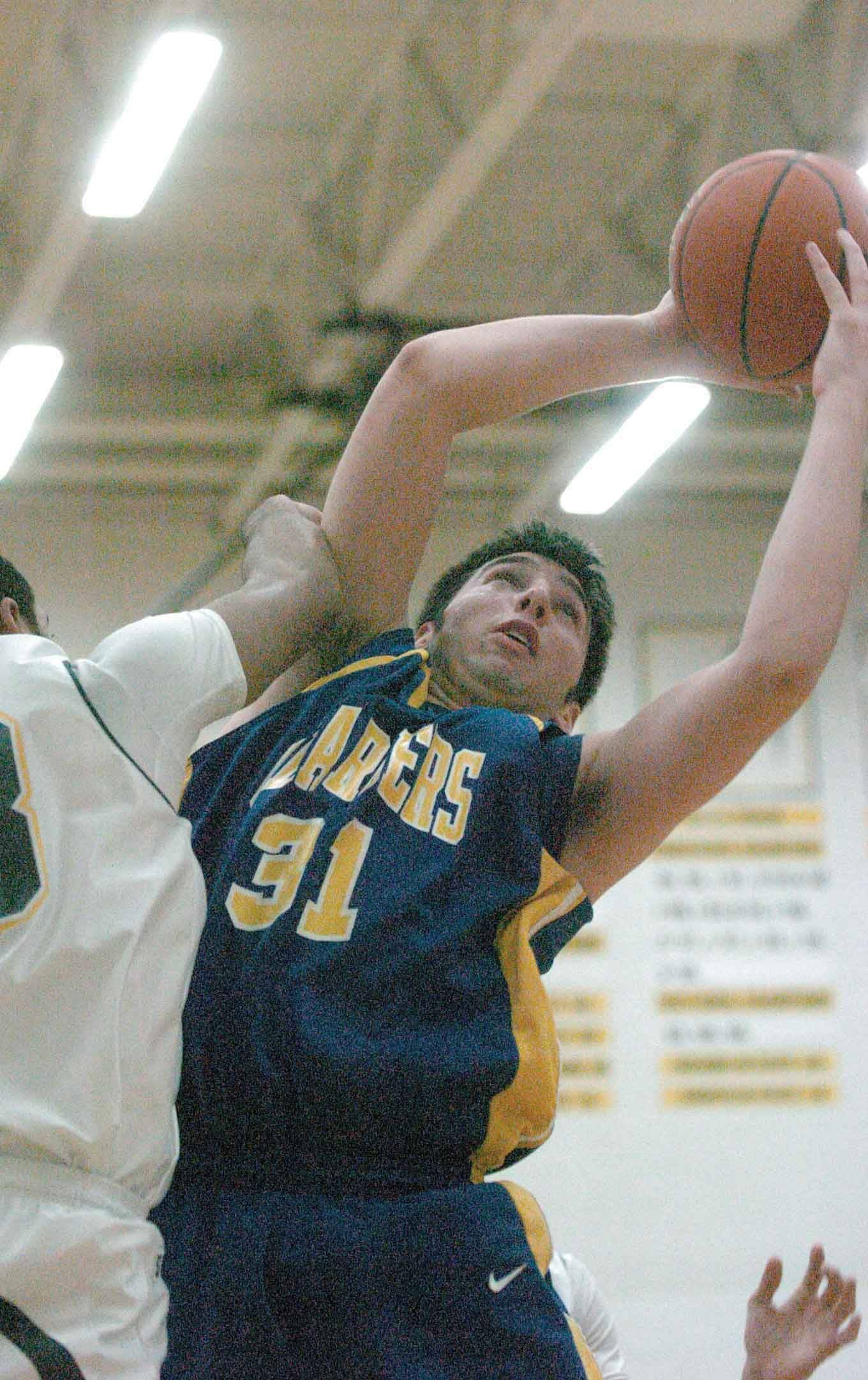 Tim Frenandez of Aurora Central goes up for a rebound .