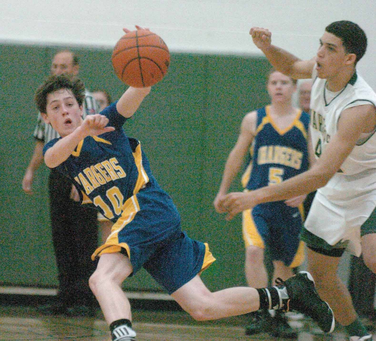 Joe Medgyesi of Aurora Central,left, tries to pull in a loose ball.