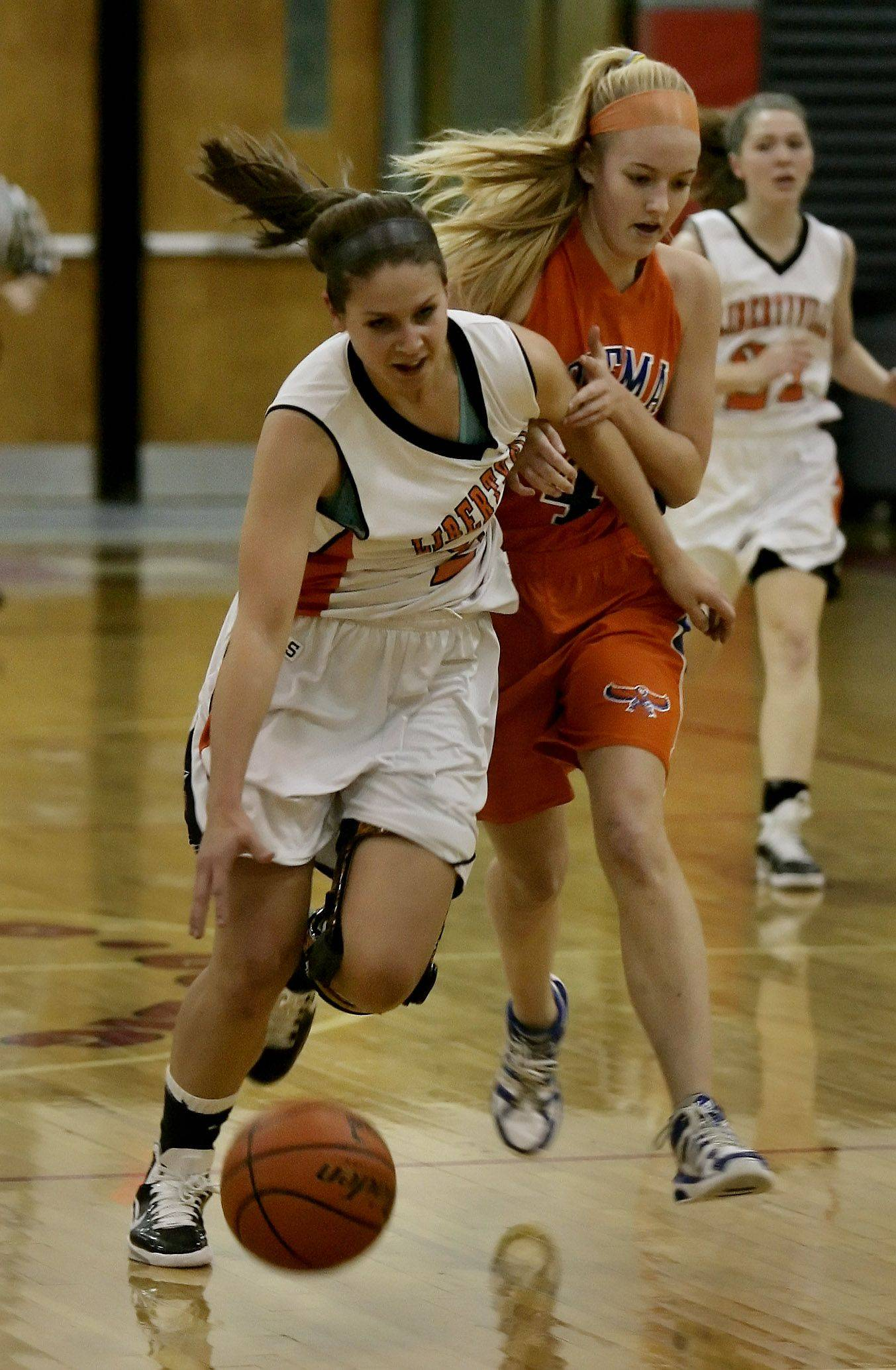 Libertyville forward Kaca Savatic is fouled as she breaks away from Hoffman Estates' guard Mary Pettit.