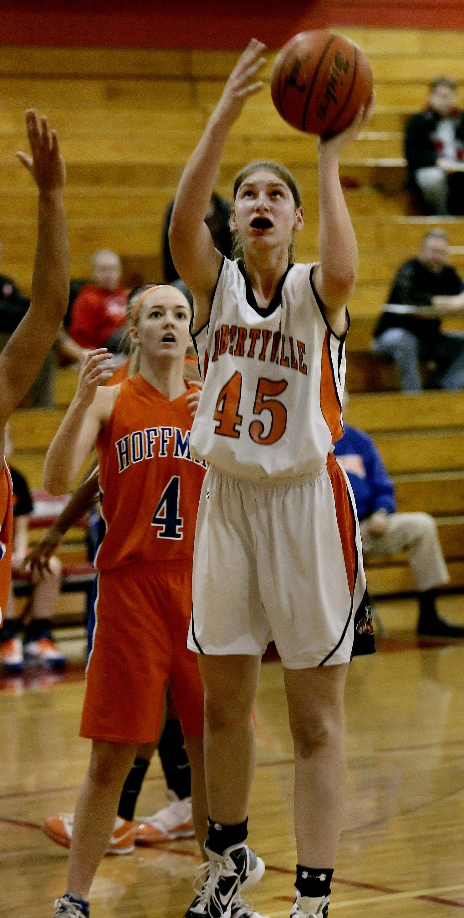 Libertyville center Nicole Kruckman goes up for a layup against Hoffman Estates.