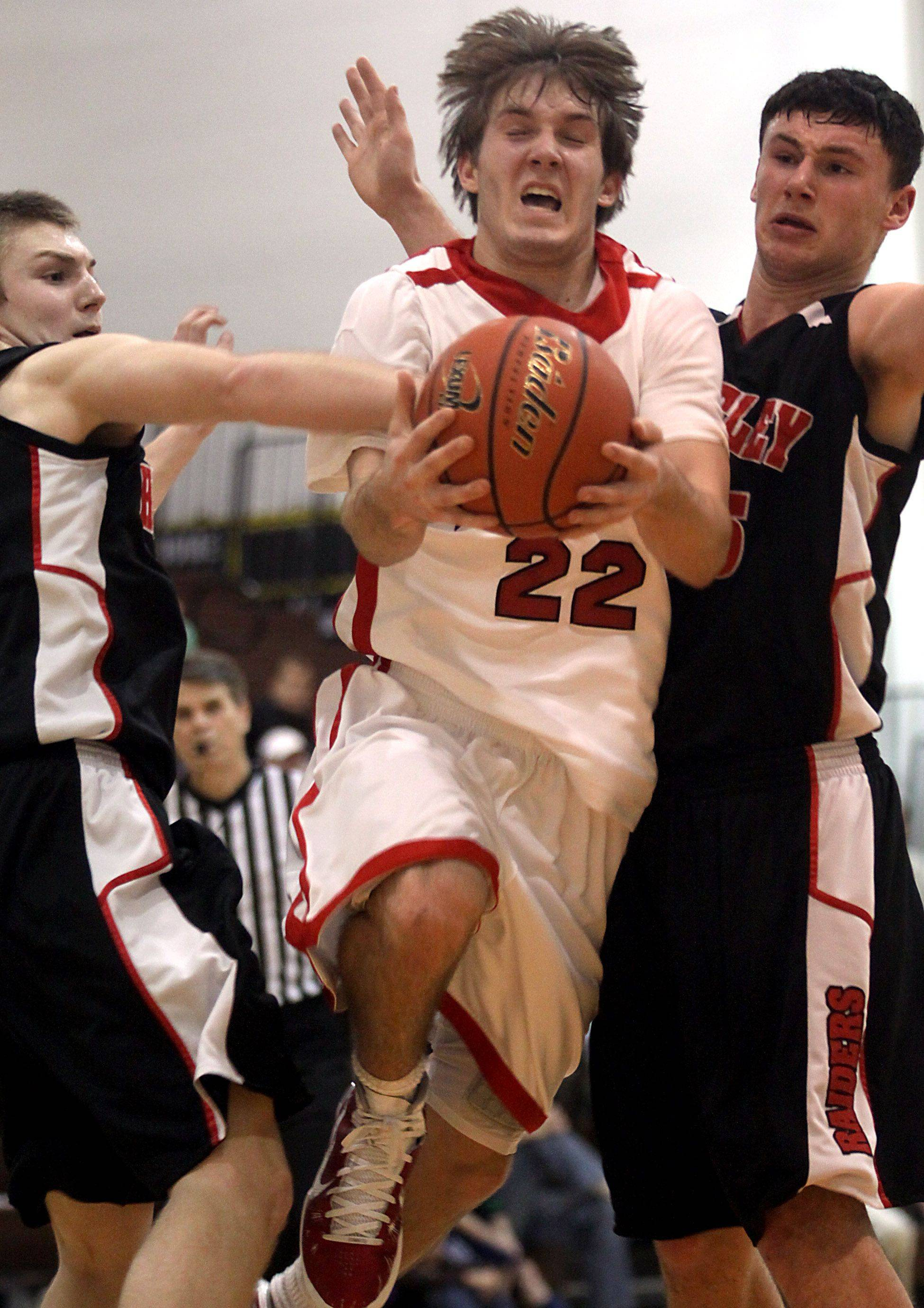Robert Knar of Mundelein splits the Huntley defense on his way to the hoop during the title game of the Jacobs Holiday Classic Boys Basketball Tournament in Algonquin.