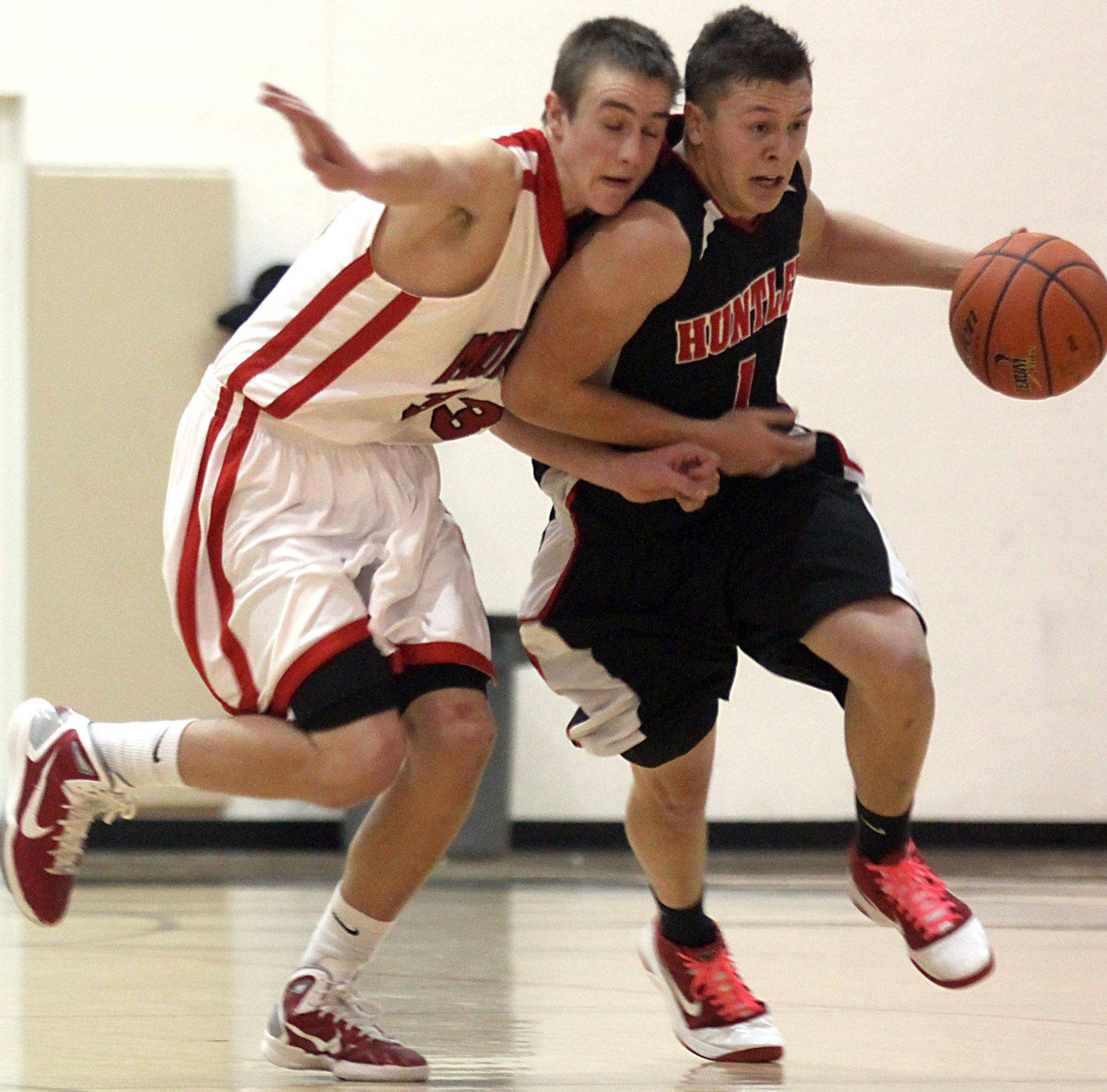 Dylan Neukirch of Huntley, right, and Sean O'Brien of Mundelein race downcourt during the title game of the Jacobs Holiday Classic Boys Basketball Tournament in Algonquin.