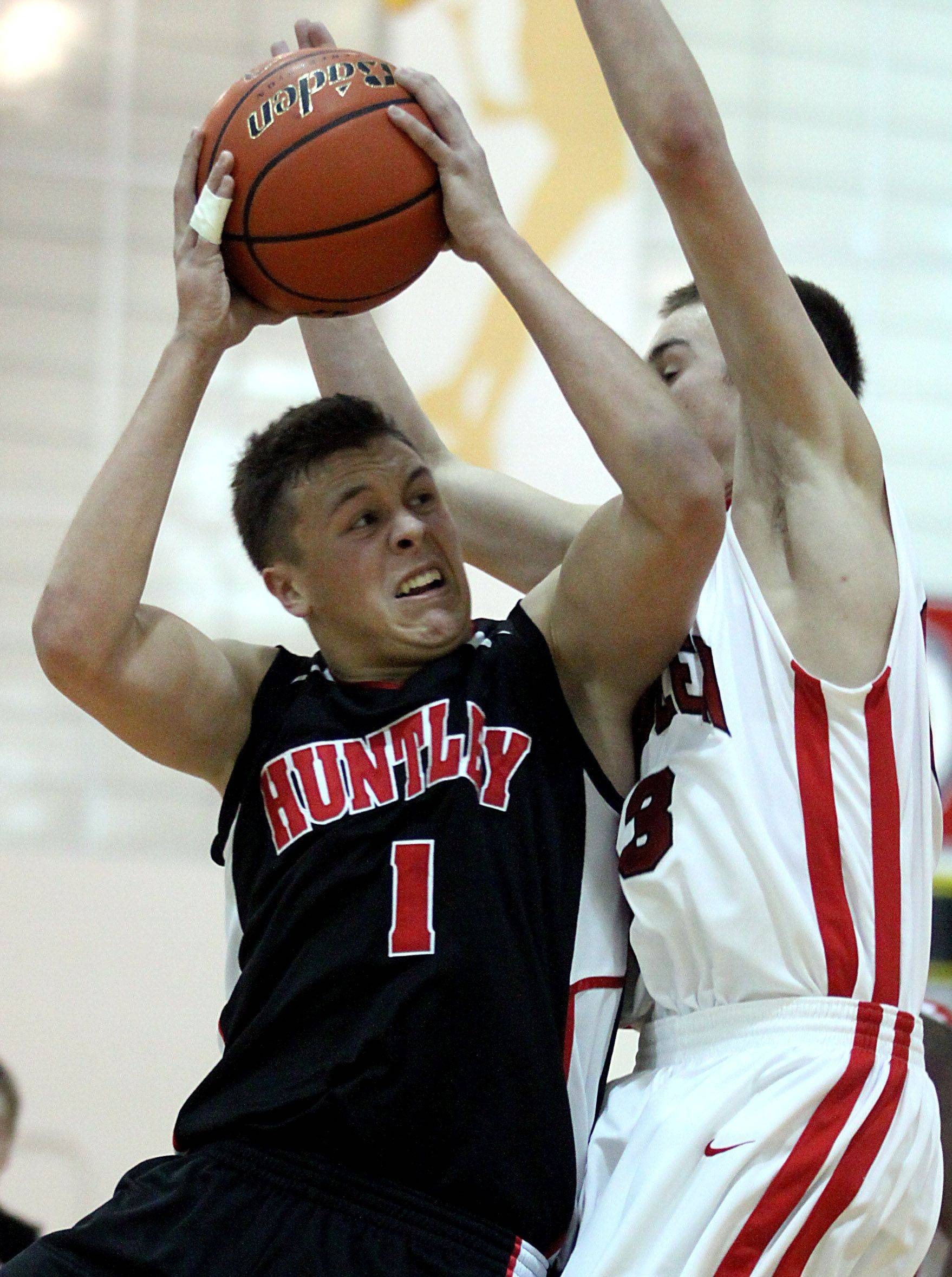 Dylan Neukirch of Huntley goes to the hoop against Mundelein during the title game of the Jacobs Holiday Classic Boys Basketball Tournament in Algonquin.