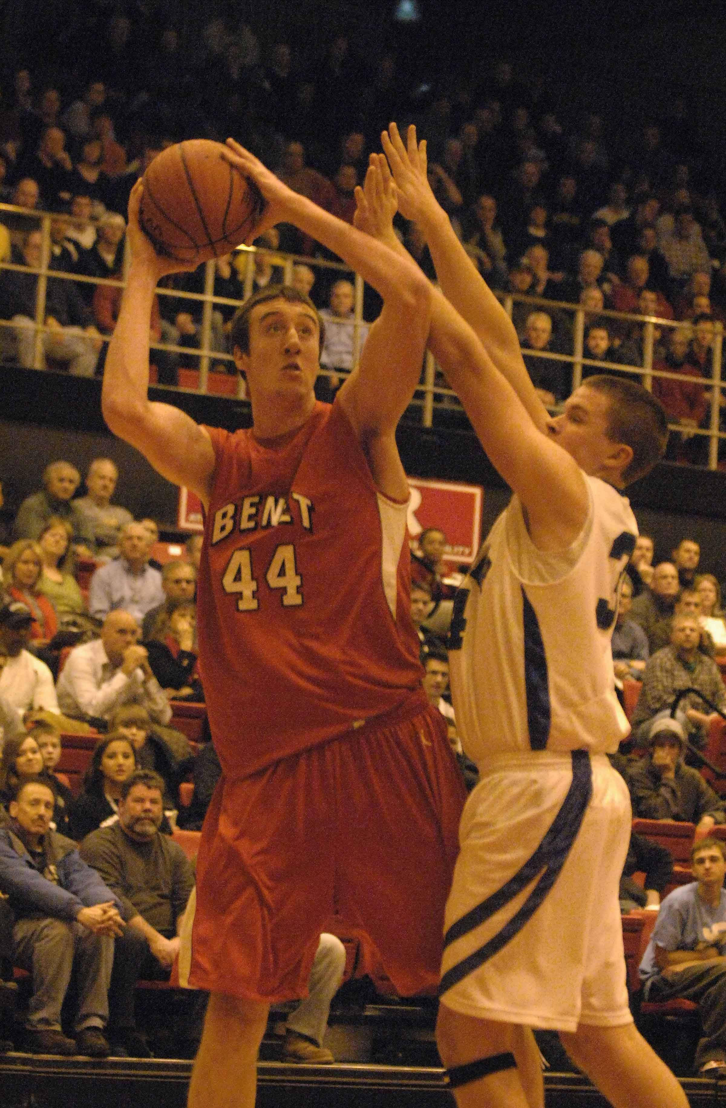 Frank Kaminsky of Benet looks to take a short during th Benet vs. New Trier boys game at Proviso West Tuesday.