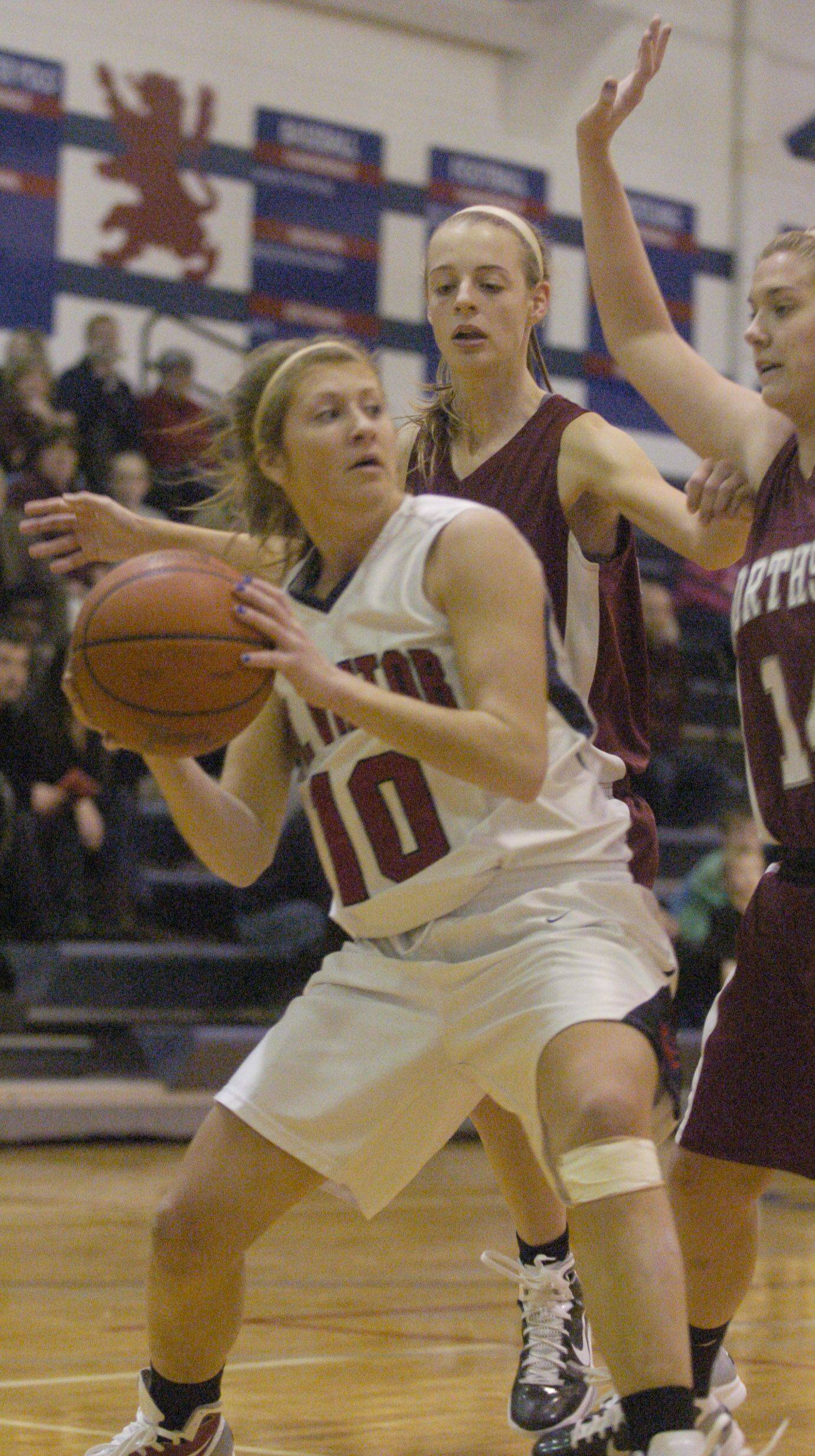 Katie Galvin of St. Viator looks to pass as Northside prep defenders Maddie Minogue, middle, and Emily Walsh close in.