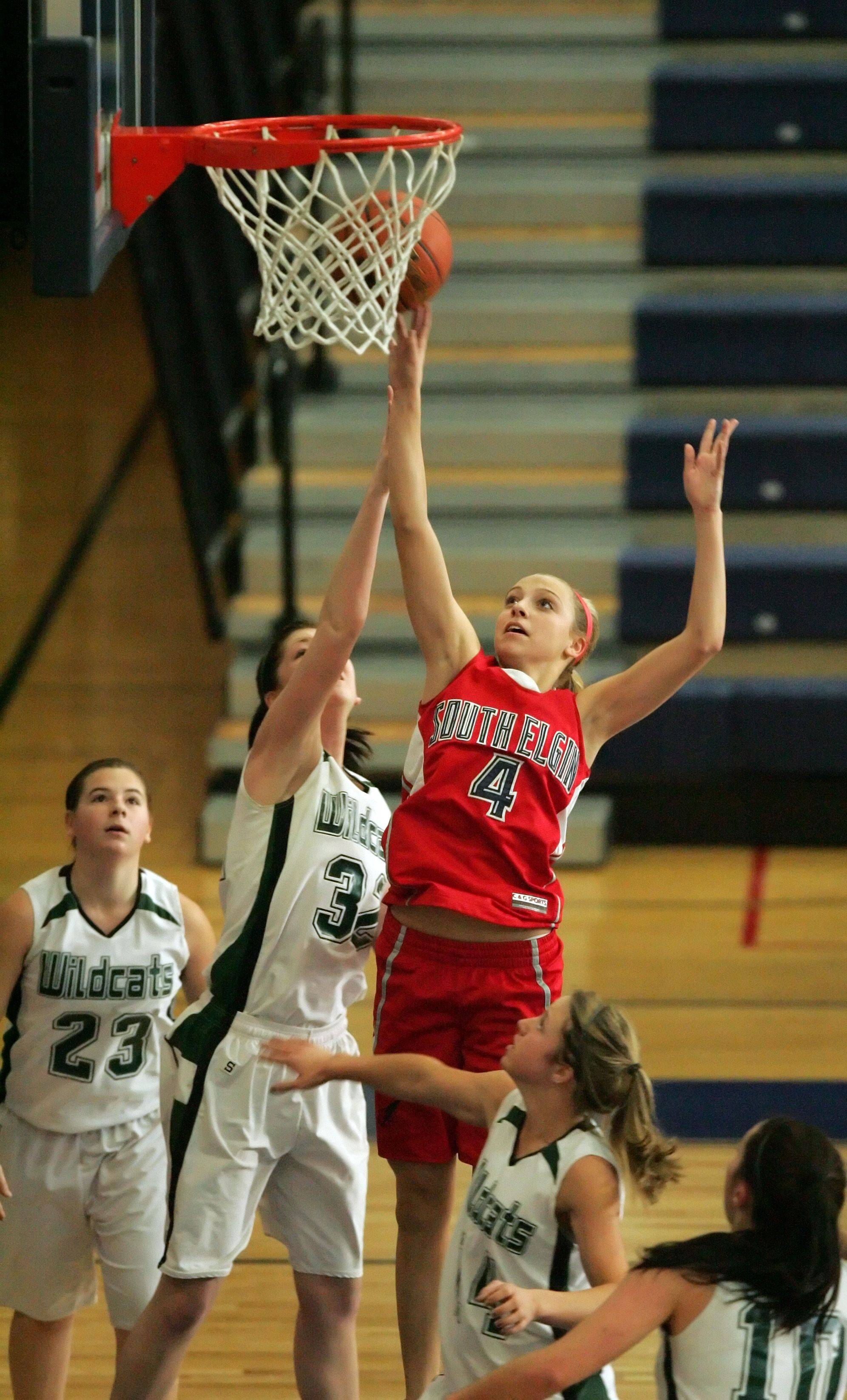 South Elgin guard Savanah Uveges (4) goes to the hoop past Plainfield Central forward Ashley Weisel Tuesday during the Storm's win at the Oswego East tournament.