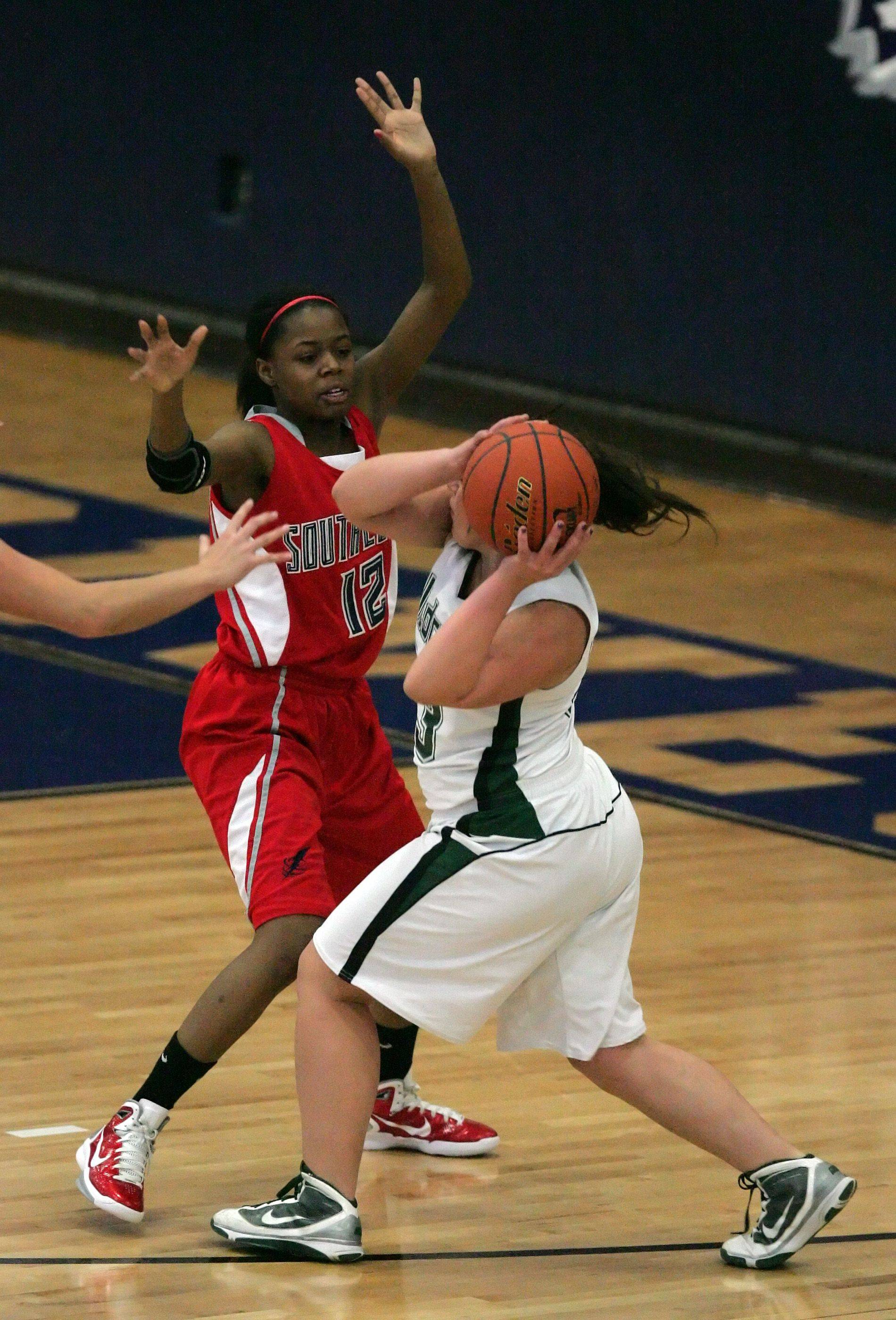 South Elgin guard Nicole Lewis (12) puts on the defensive pressure during action at the Oswego East tournament Tuesday.