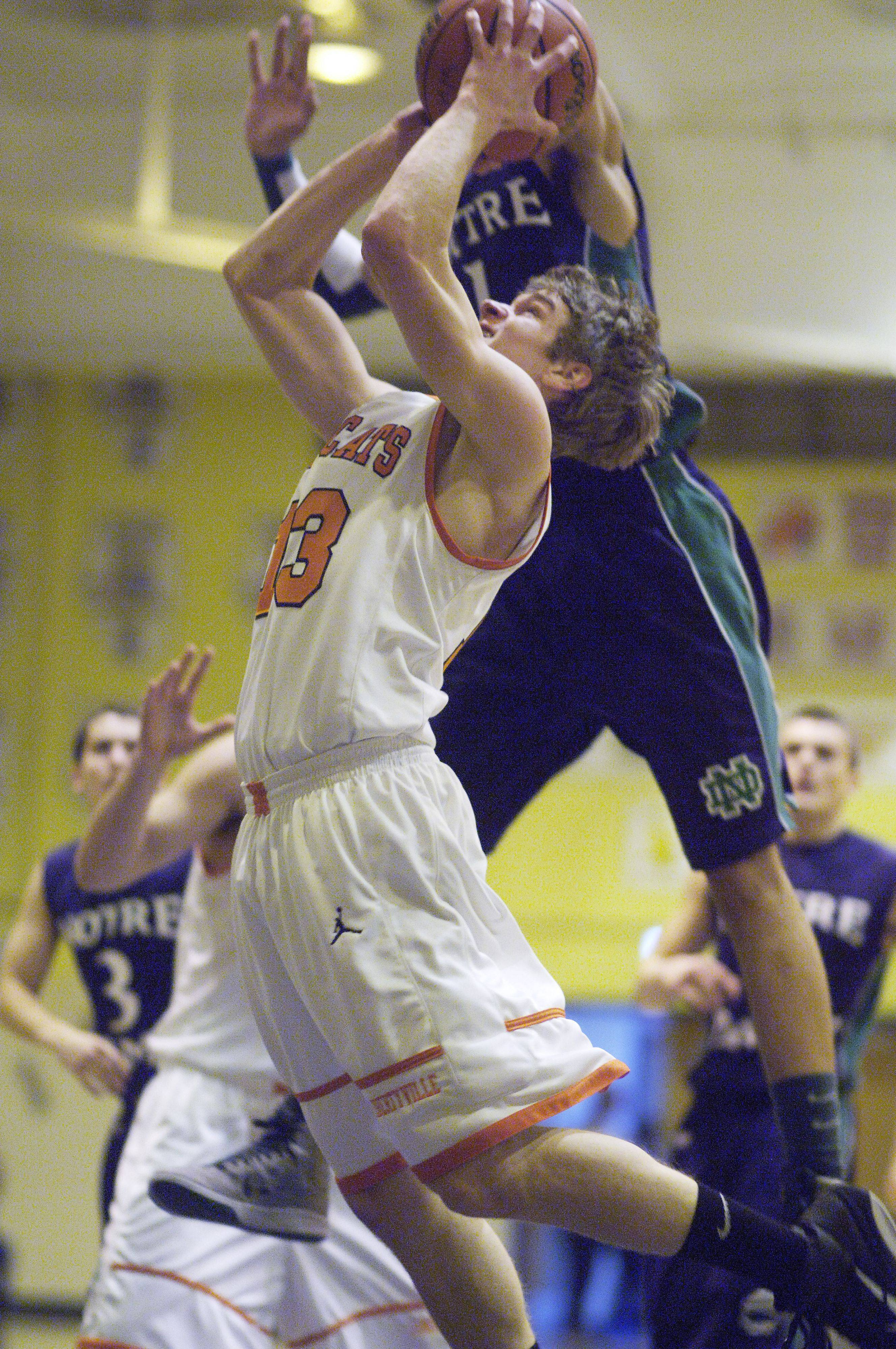 Libertyville's Anthony Mack meets Notre Dame's Quinton Chievous at the basket during the Wheeling Tournament Wednesday.
