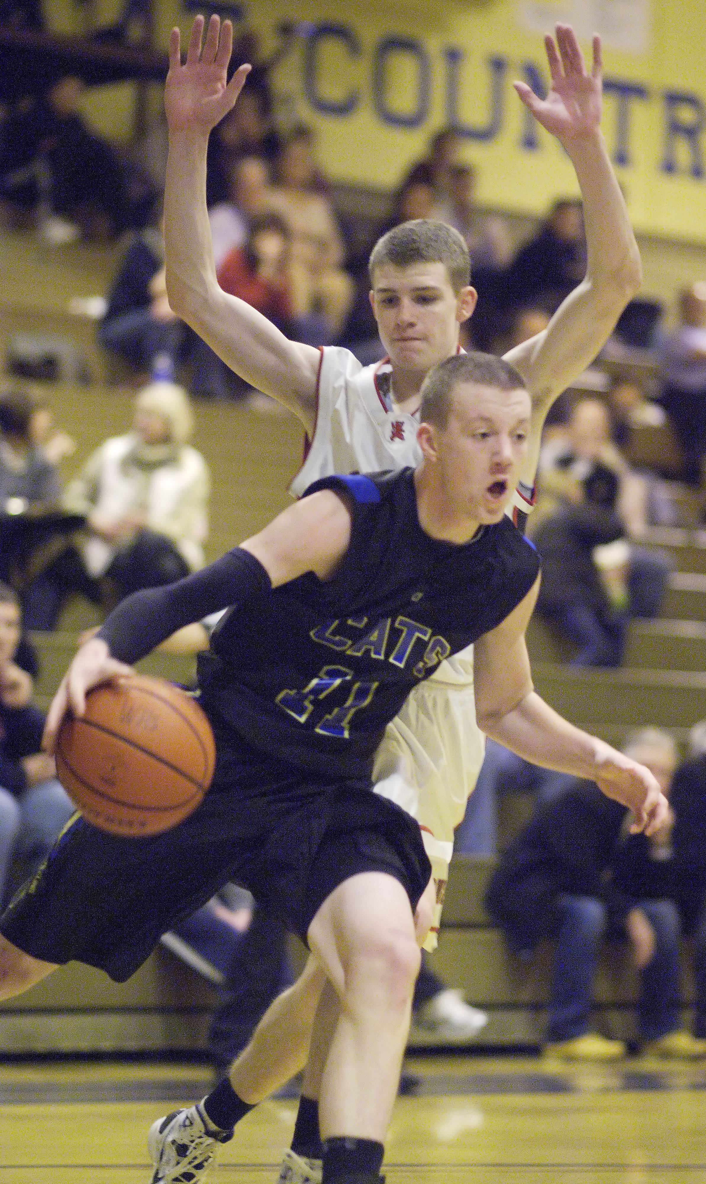 Wheeling's Ricky Schwind drives past St. Viator's Kevin Walsh during the Wheeling Tournament Wednesday.