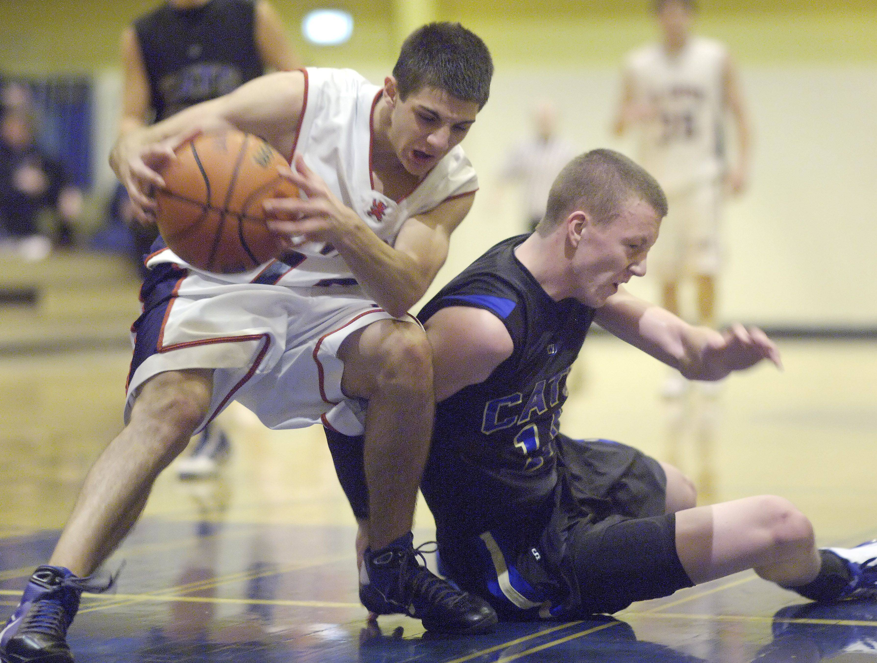St. Viator's D.J. Morris, left, gets to a loose ball ahead of Wheeling's Ricky Schwind during the Wheeling Tournament Wednesday.