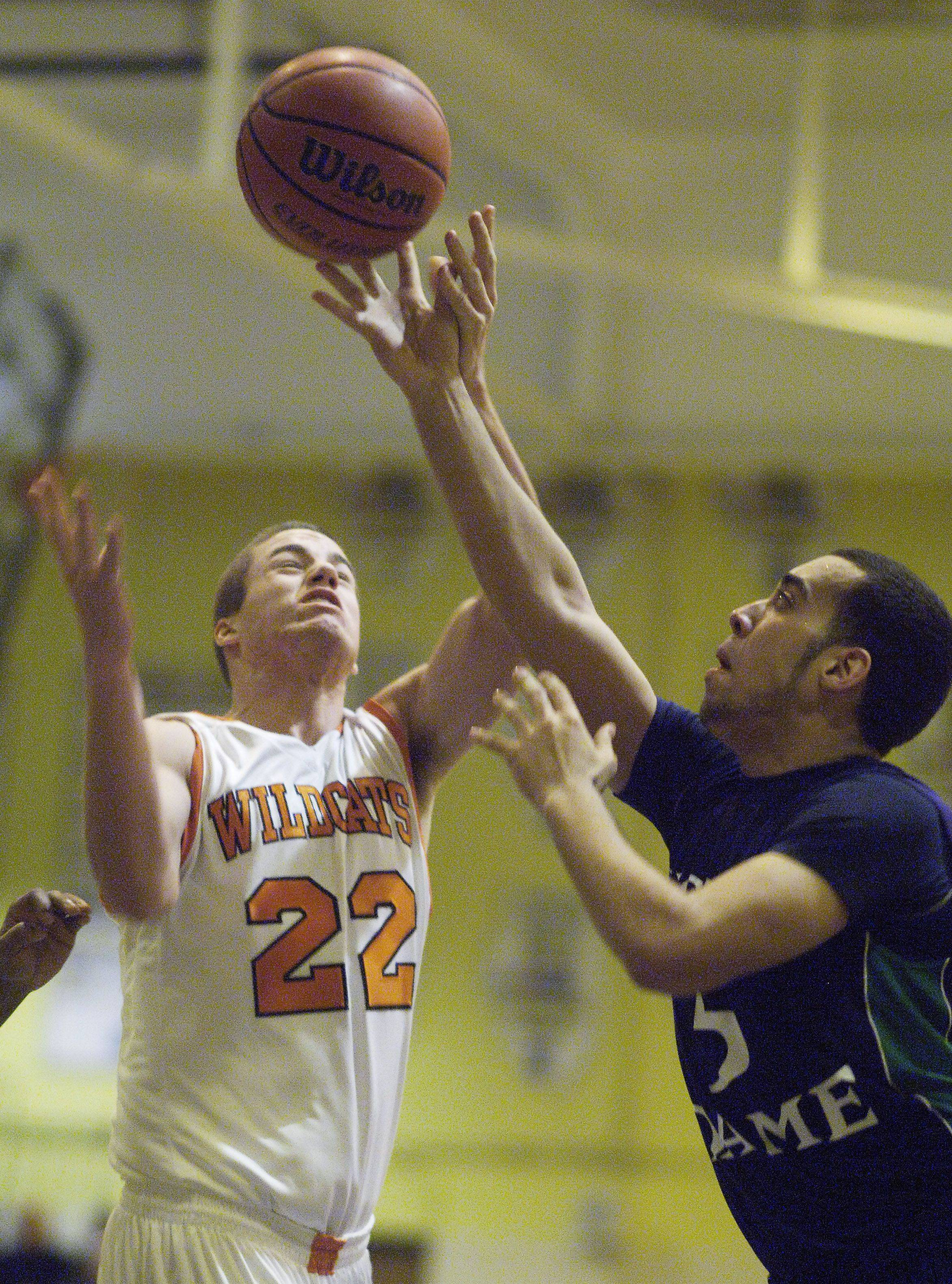 Notre Dame's Eddie Serrano gets his fingertips on the ball as Libertyville's Joey Eichmann drives to the basket during the Wheeling Tournament Wednesday.