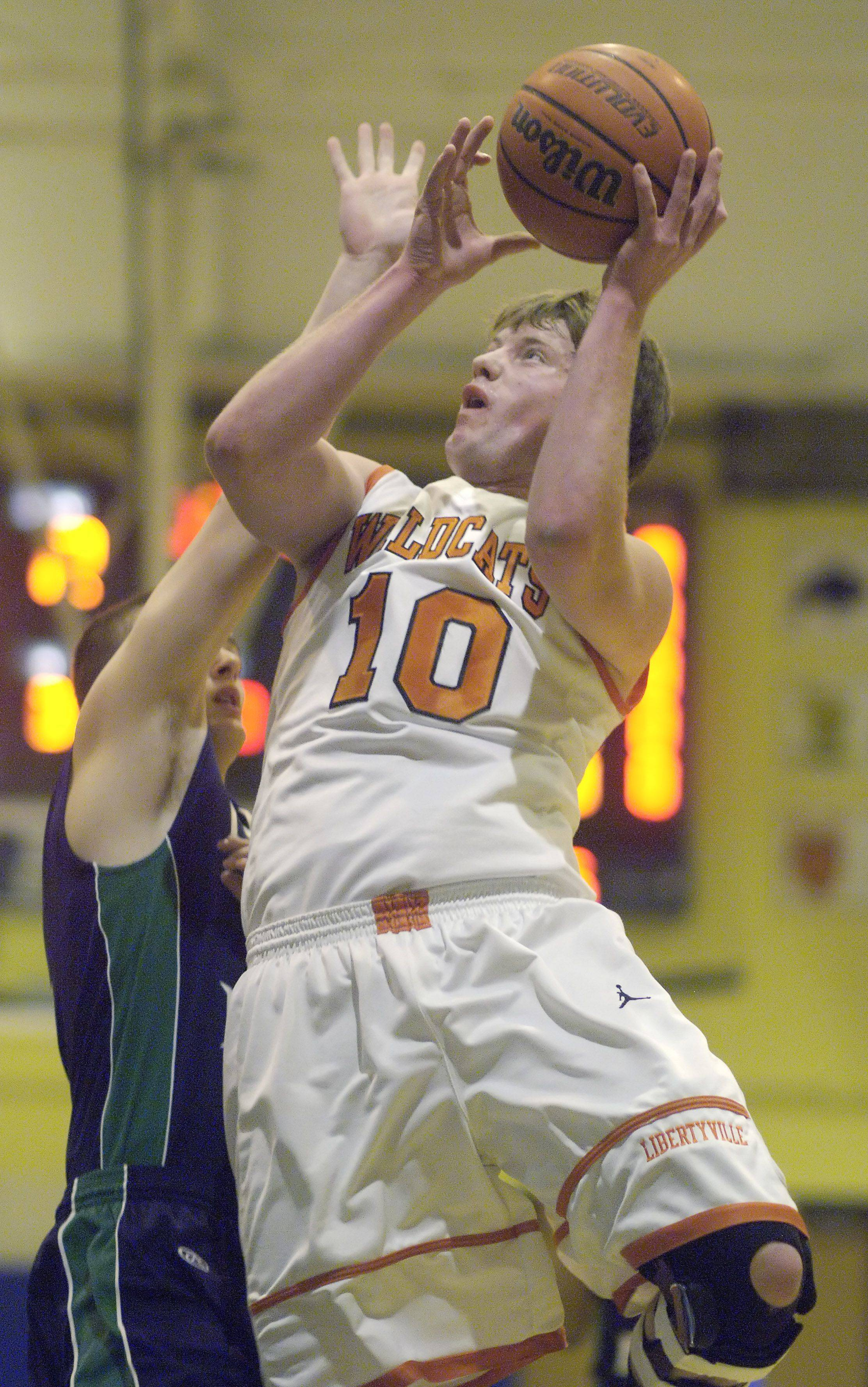 Libertyville's Luke Mathewson drives hard to the basket against Notre Dame during the Wheeling Tournament Wednesday.