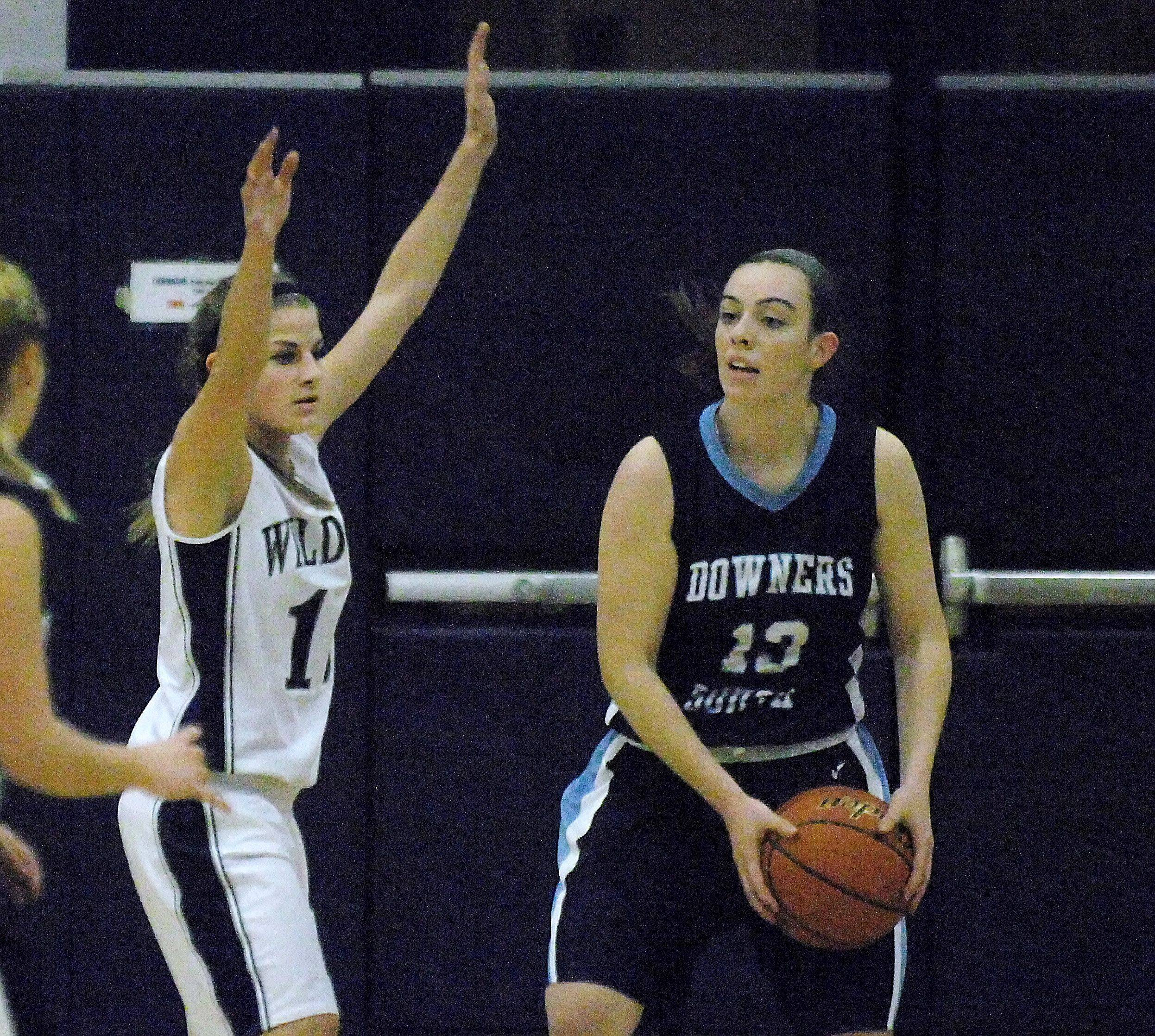 Images of West Chicago vs. Downers Grove South girls basketball in Oswego.