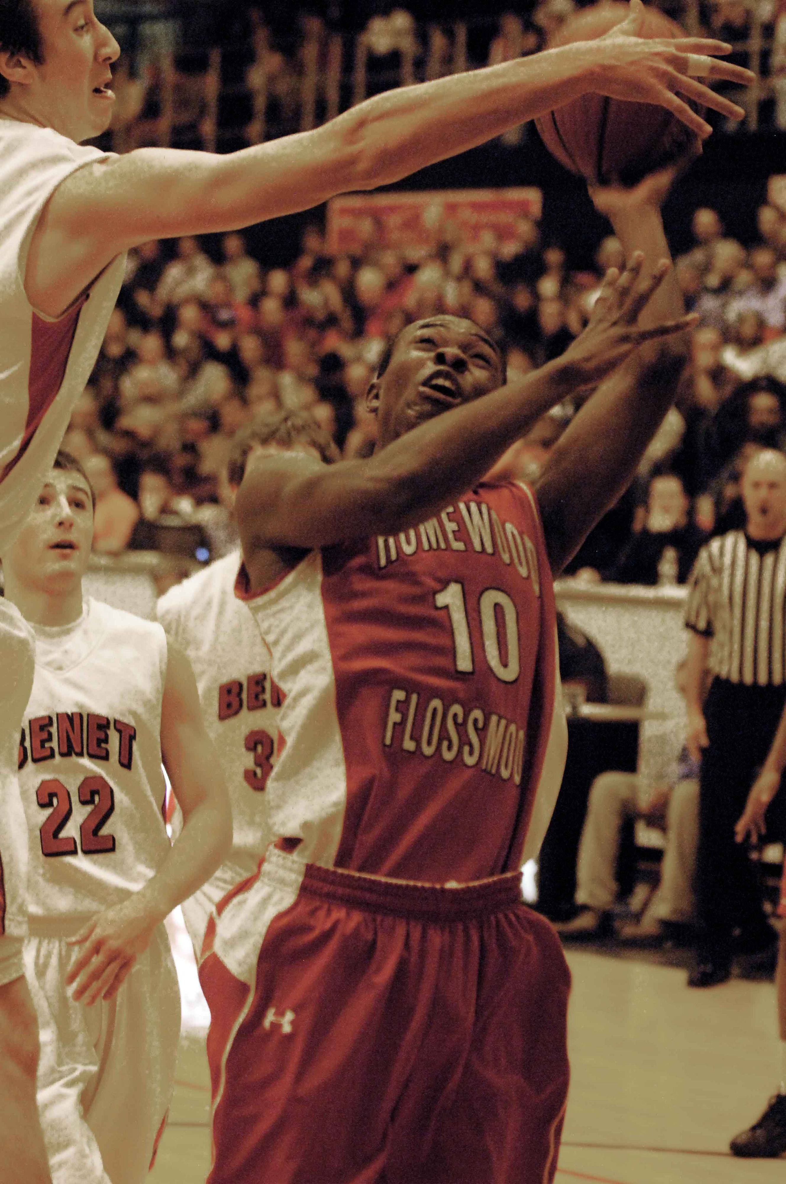 Frank Kaminsky of Benet,left, blocks a shot from Tyrone Sherman of Homewood-Floosmoor. This took place during the Benet vs. Homewood-Flossmoor game at Proviso West High School in Hillside Thursday.